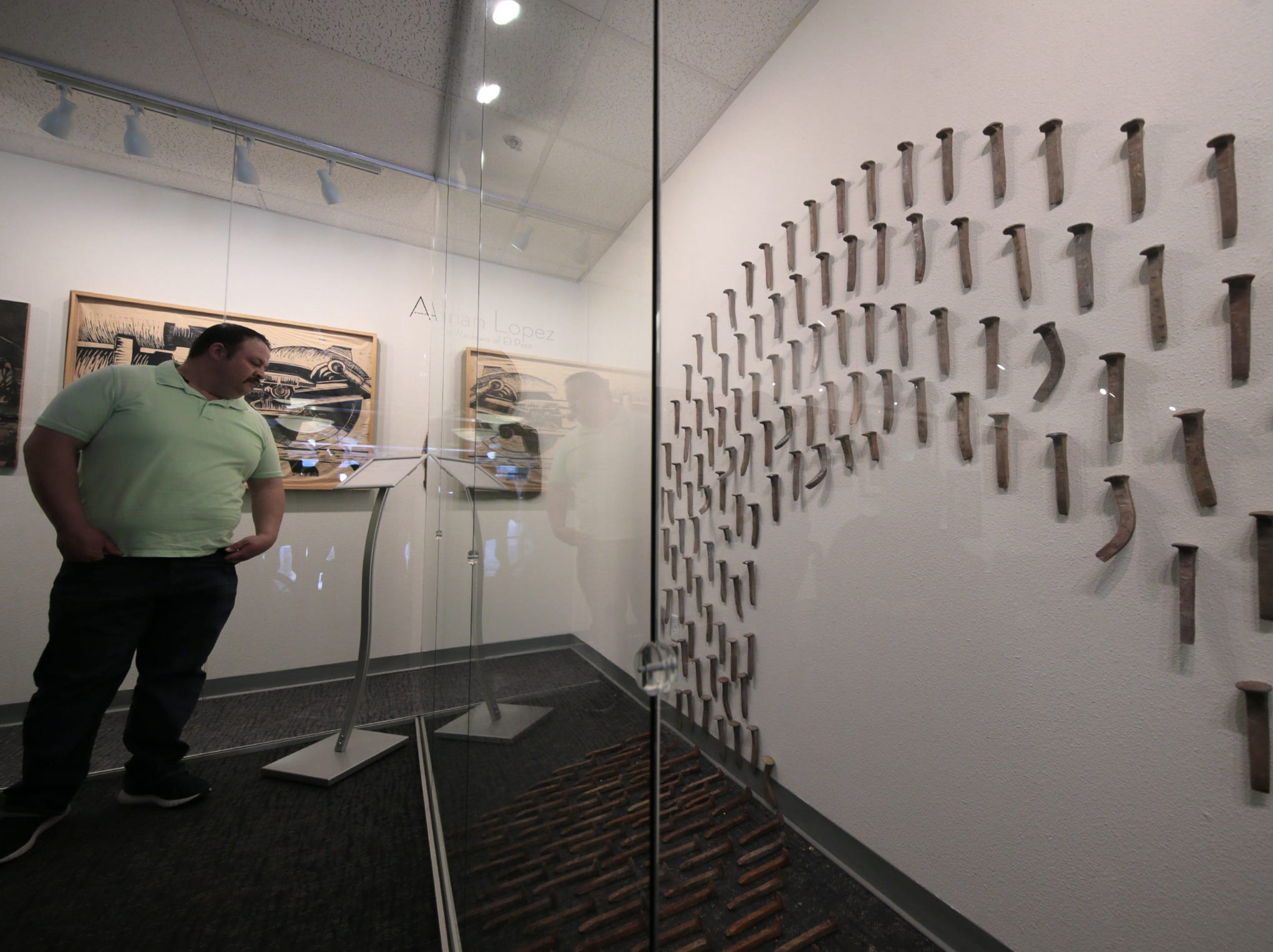 The Art Windows of El Paso at the El Paso International Airport held a ribbon cutting for an exhibit by artists Adrian Lopez and Ramiro Ordonez.
