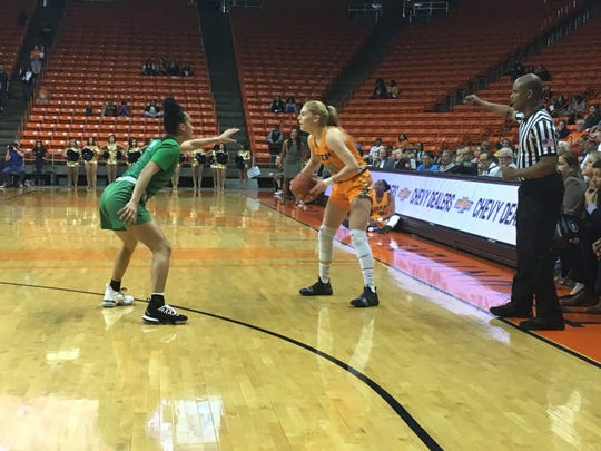 UTEP's Katarina Zec looks for a passing lane against North Texas' Callie Owens Thursday night at the Don Haskins Center