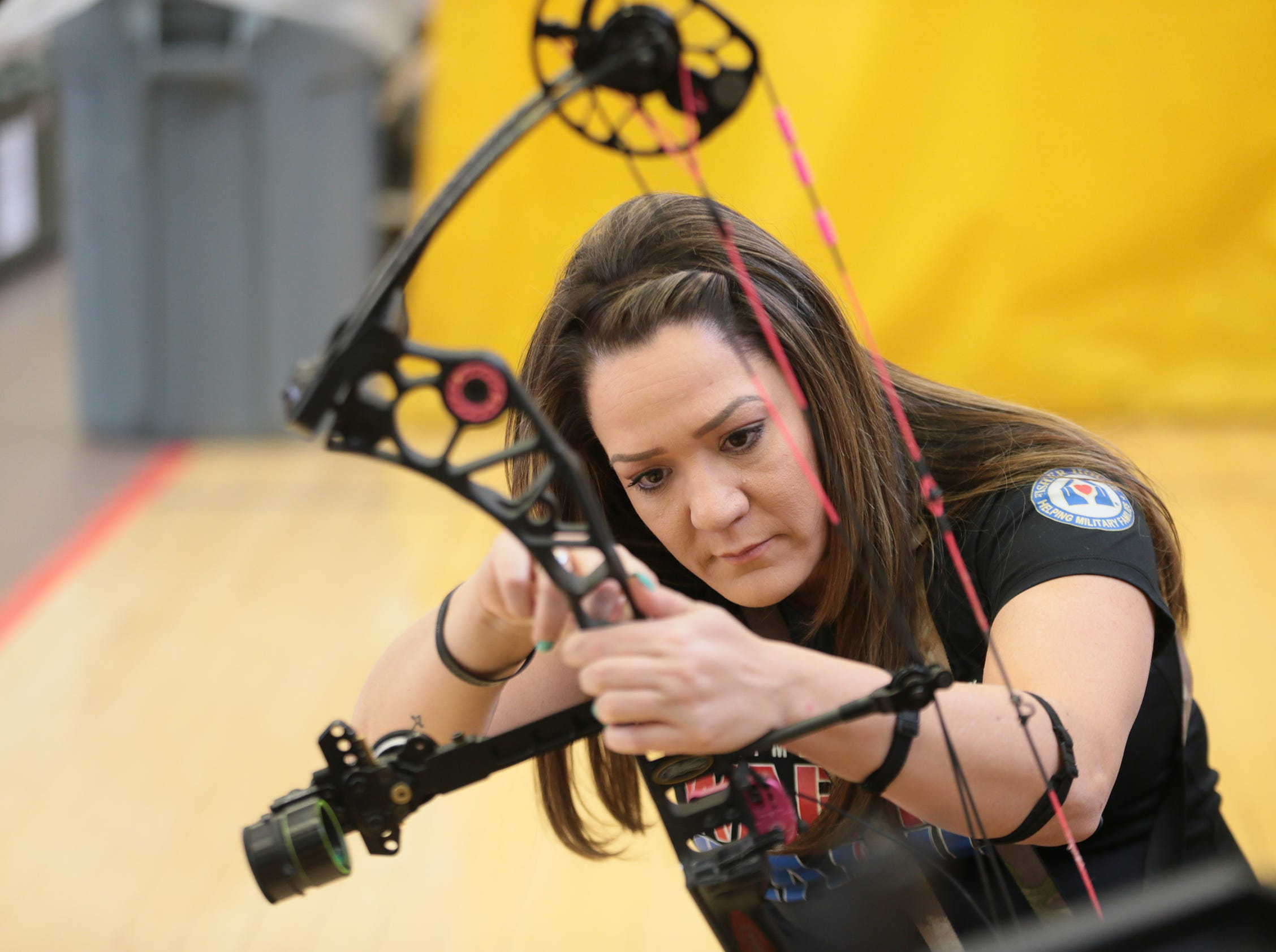 An athlete prepares her bow as soldiers from across the Army were at Fort Bliss on Friday, March 8, 2019, competing at the U.S. Army Warrior Trials in a bid to represent the Army at the Department of Defense Warrior Games in Tampa, Fla., in the summer. The competition is open to active duty, veterans, Reserve and National Guard members.