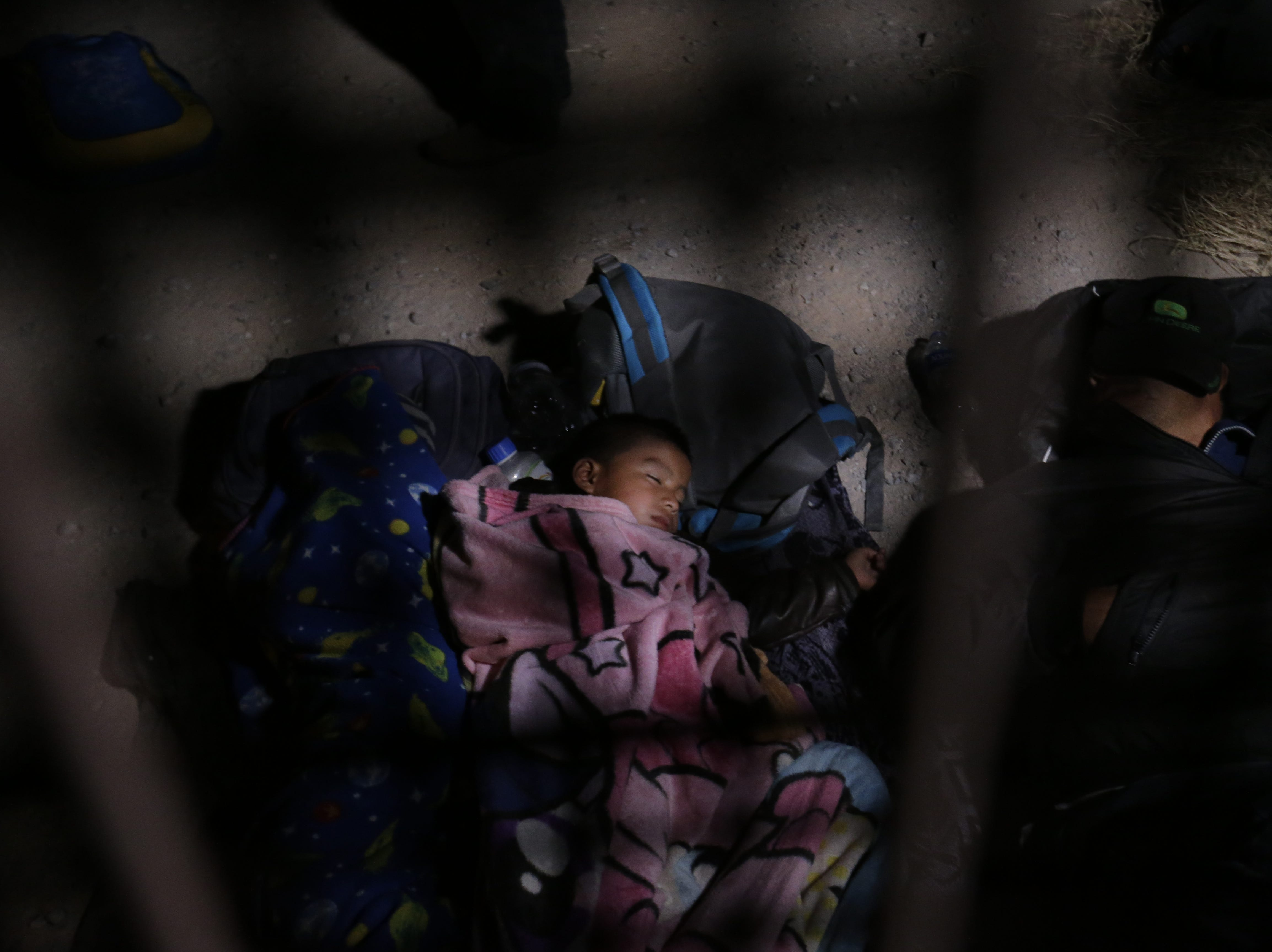 A group of 60 migrants from Guatemala, including children, awaited Border Patrol at a border in El Paso, Texas overnight.