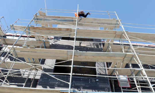Construction takes place on a residential complex in Ventura County.