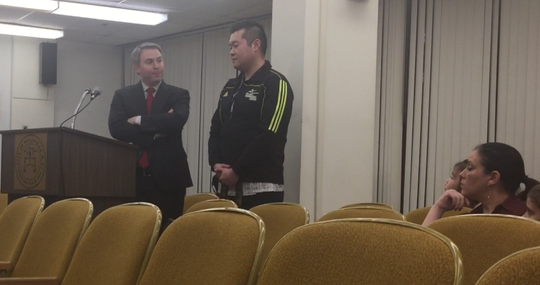 Attorney Matthew Robinson (left) and Hyuntae Jung of U.S. Taekwondo Center testify before the Millville Zoning Board Thursday night about Jung relocating to 113 N. High St.