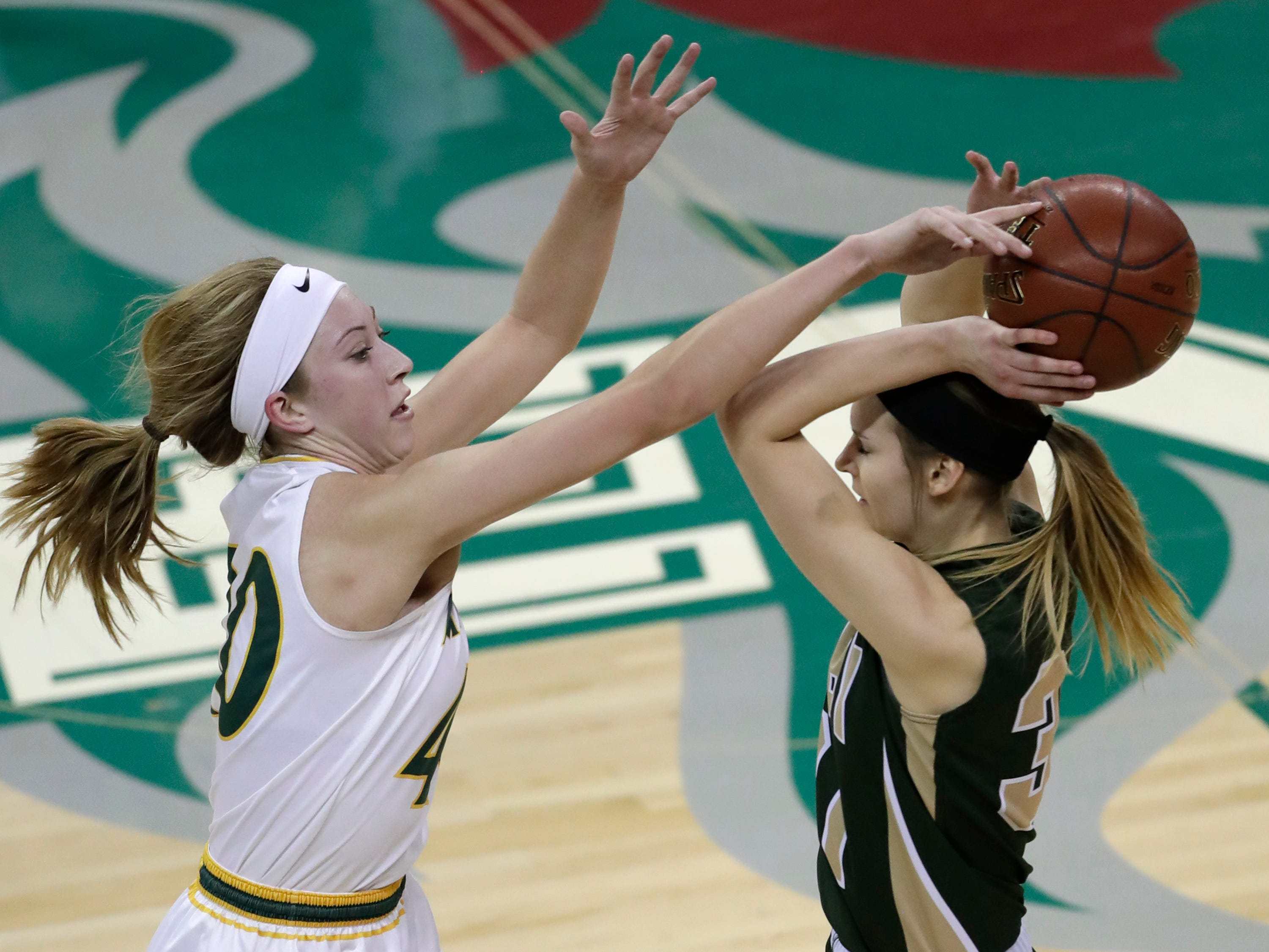 Melrose-Mindoro's Emily Herzberg (40) defends against Colby's Alyssa Underwood (31) during their Division 4 semifinal game at the WIAA girls state basketball tournament Thursday, March 7, 2019, at the Resch Center in Ashwaubenon, Wis.