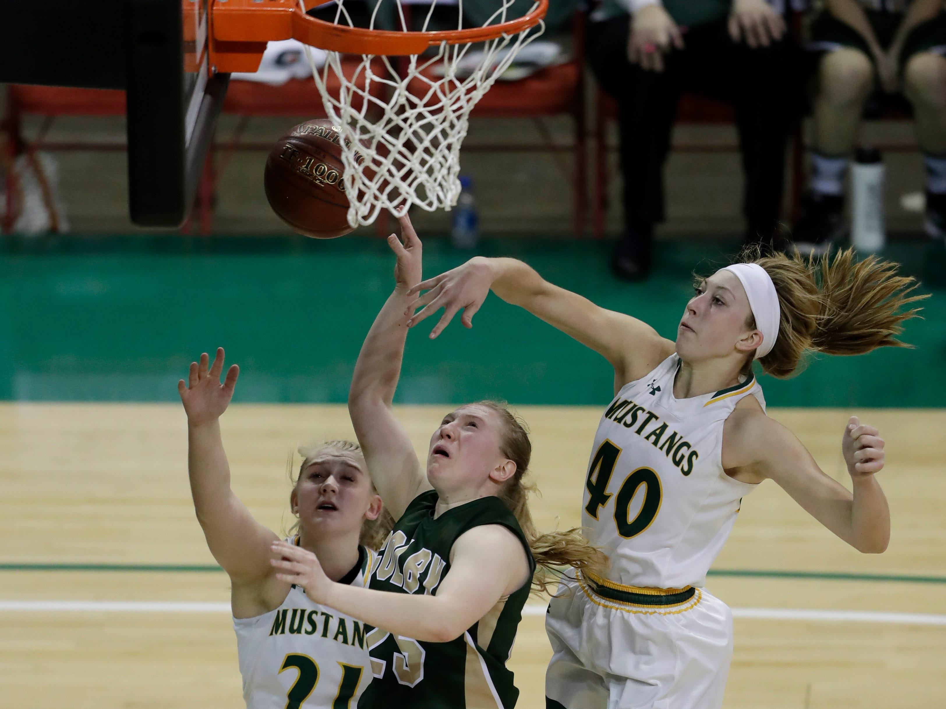 Colby's Ashley Streveler (25) is fouled by Melrose-Mindoro's Emily Herzberg (40) during their Division 4 semifinal game at the WIAA girls state basketball tournament Thursday, March 7, 2019, at the Resch Center in Ashwaubenon, Wis.