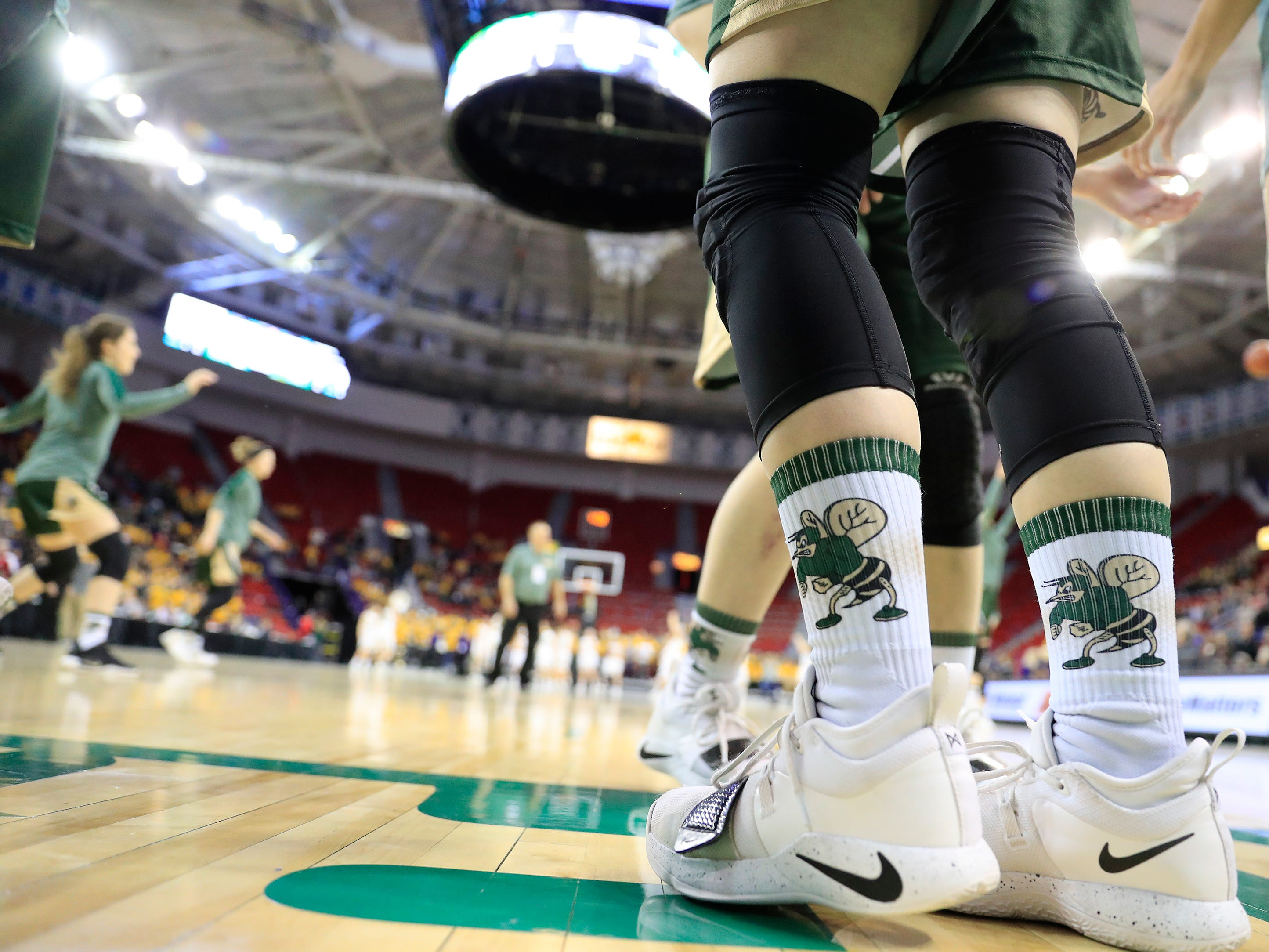 Colby players warm up for a Division 3 semifinal at the WIAA state girls basketball tournament at the Resch Center on Thursday, March 7, 2019, in Ashwaubenon, Wis.