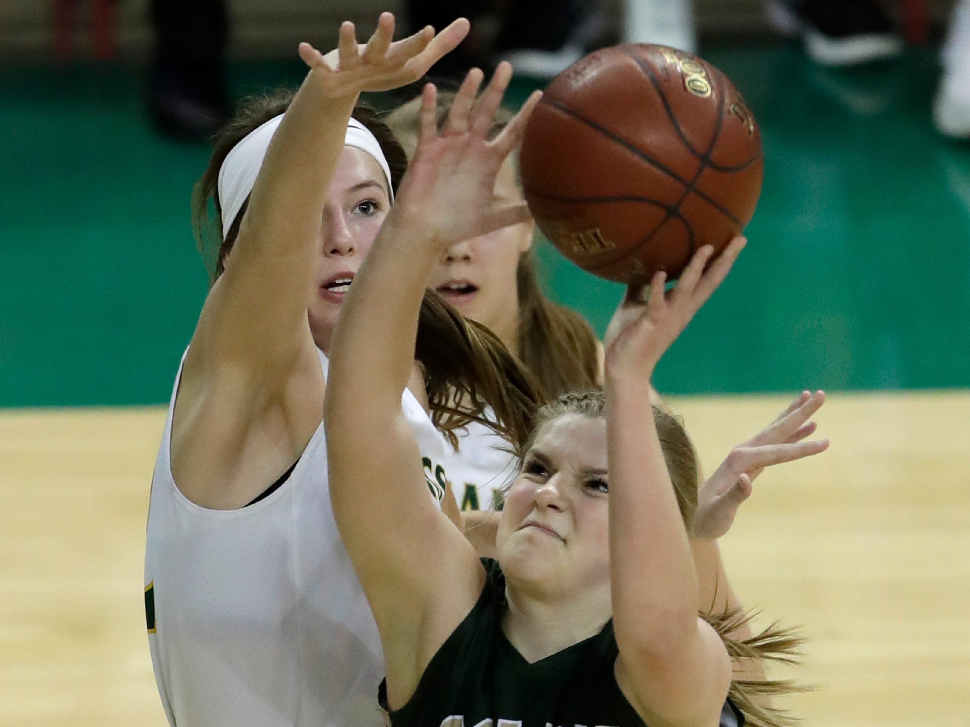 Colby's Lexi Underwood (24) puts up a shot against Melrose-Mindoro's Calette Lockington (10) during their Division 4 semifinal game at the WIAA girls state basketball tournament Thursday, March 7, 2019, at the Resch Center in Ashwaubenon, Wis.