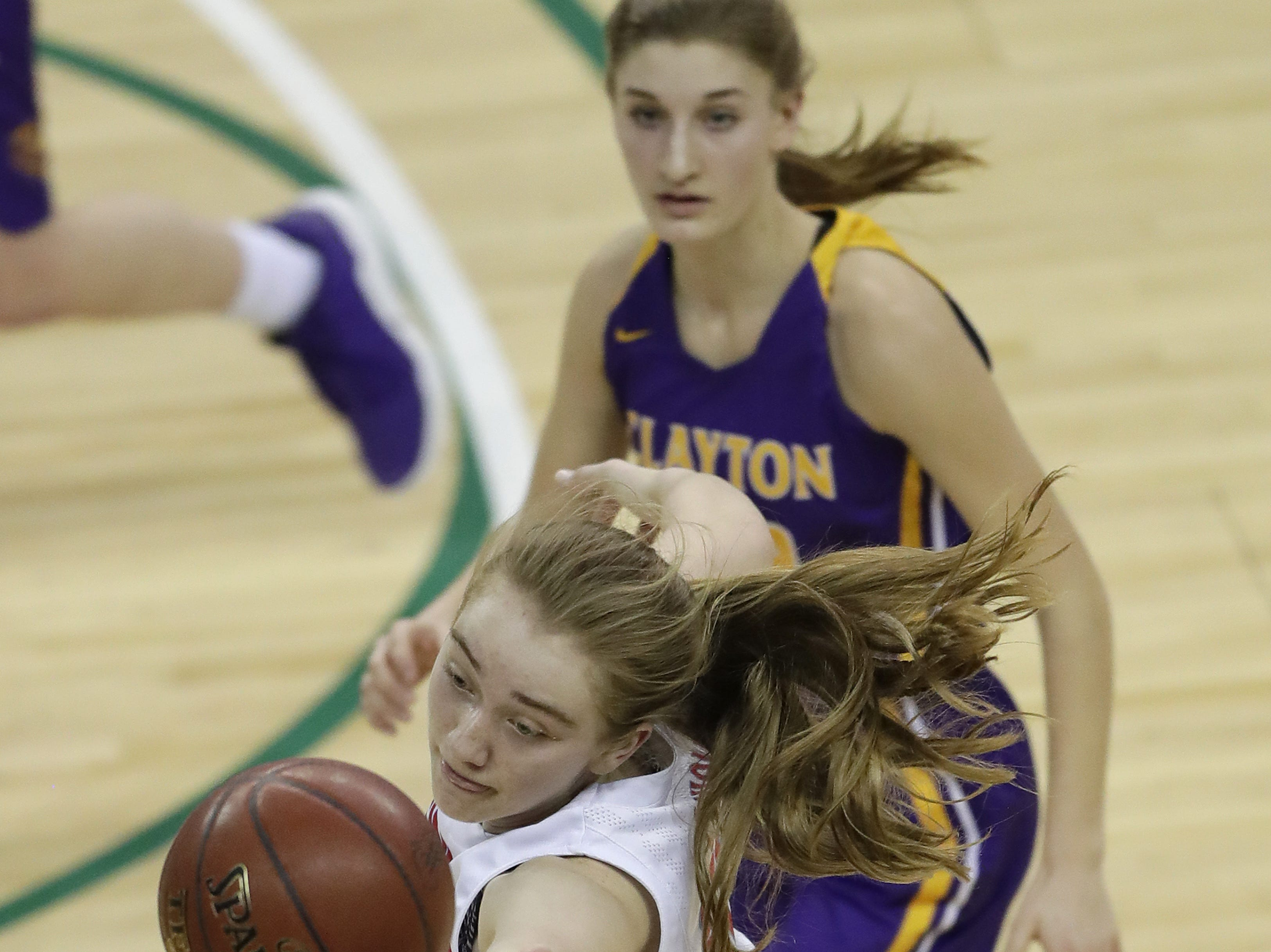 Wausau Newman Catholic's Jadelyn Ganski (33) gains control of the ball against Clayton's Jaedyn Bussewitz (22) during their Division 5 semifinal game at the WIAA girls state basketball tournament Friday, March 8, 2019, at the Resch Center in Ashwaubenon, Wis.  Dan Powers/USA TODAY NETWORK-Wisconsin