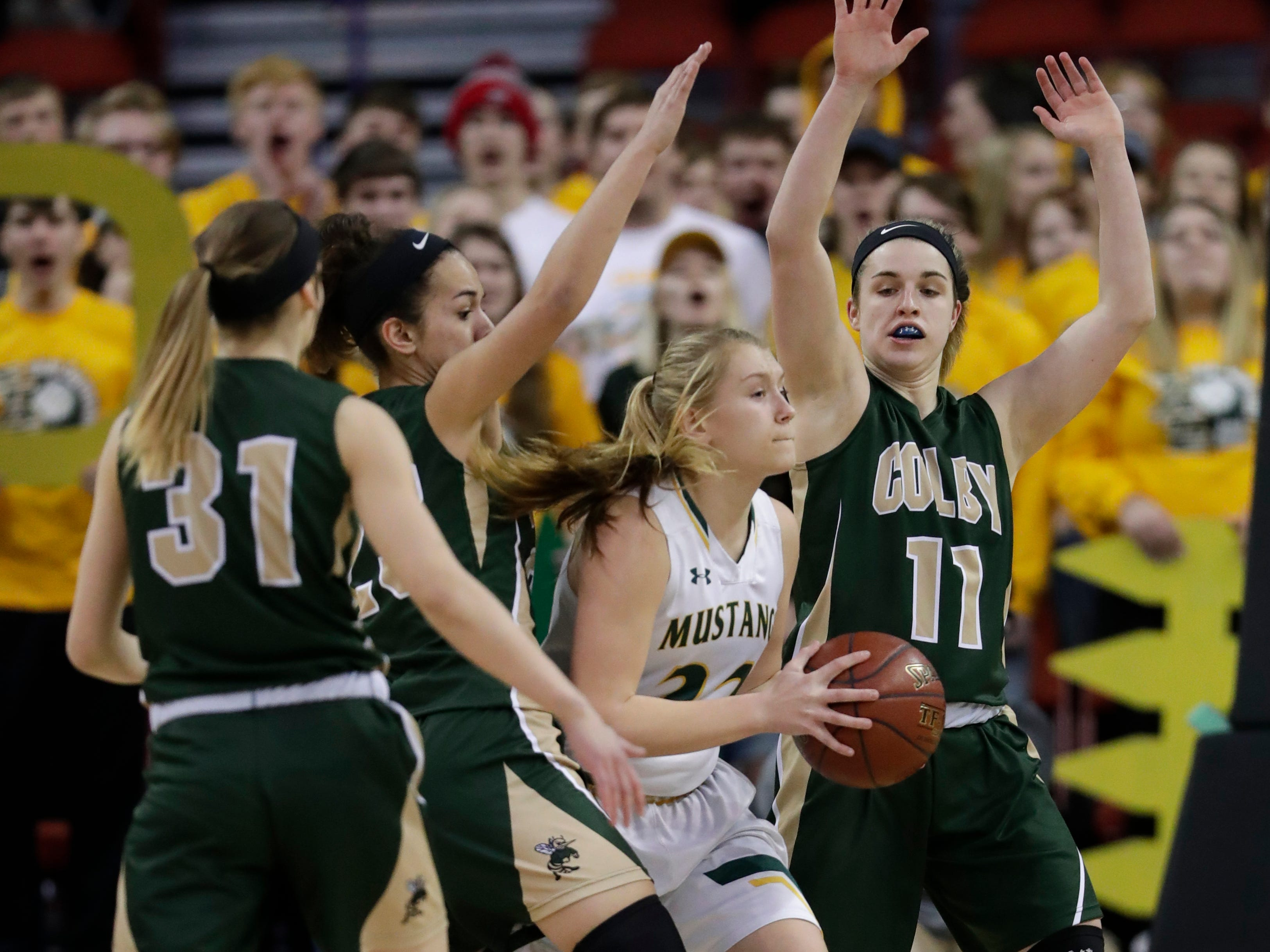 Colby's Brooke Suckow (22) is under heavy pressure by Melrose-Mindoro defenders during their Division 4 semifinal game at the WIAA girls state basketball tournament Thursday, March 7, 2019, at the Resch Center in Ashwaubenon, Wis.