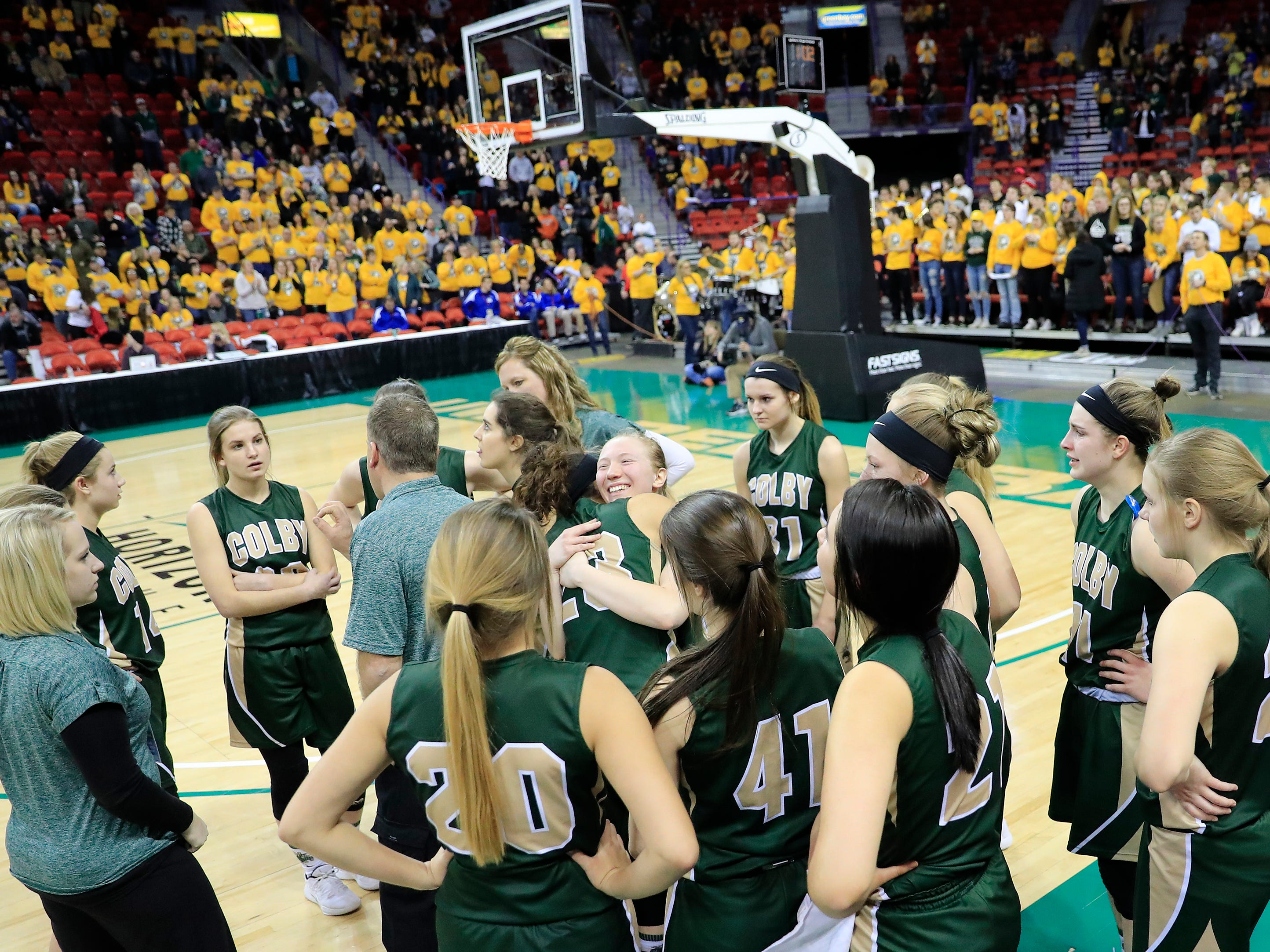 Colby players embrace during a timeout in the final minute against Melrose-Mindoro in a Division 3 semifinal at the WIAA state girls basketball tournament at the Resch Center on Thursday, March 7, 2019, in Ashwaubenon, Wis.