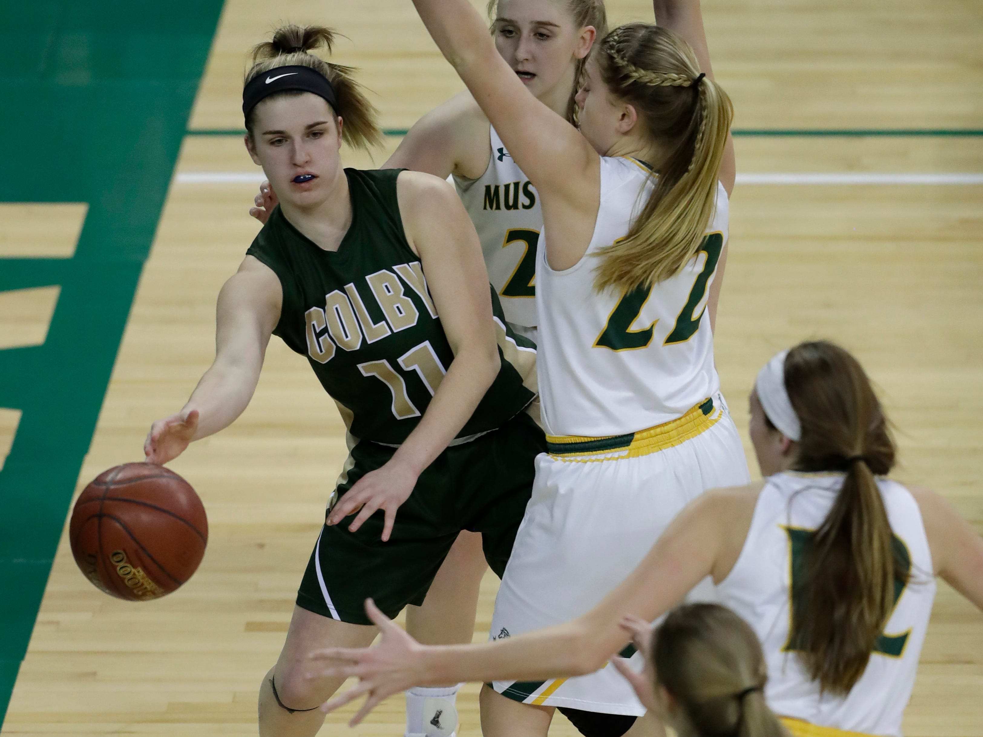 Colby's Hailey Voelker (11) passes the ball to Lexi Underwood (24) against Melrose-Mindoro during their Division 4 semifinal game at the WIAA girls state basketball tournament Thursday, March 7, 2019, at the Resch Center in Ashwaubenon, Wis.