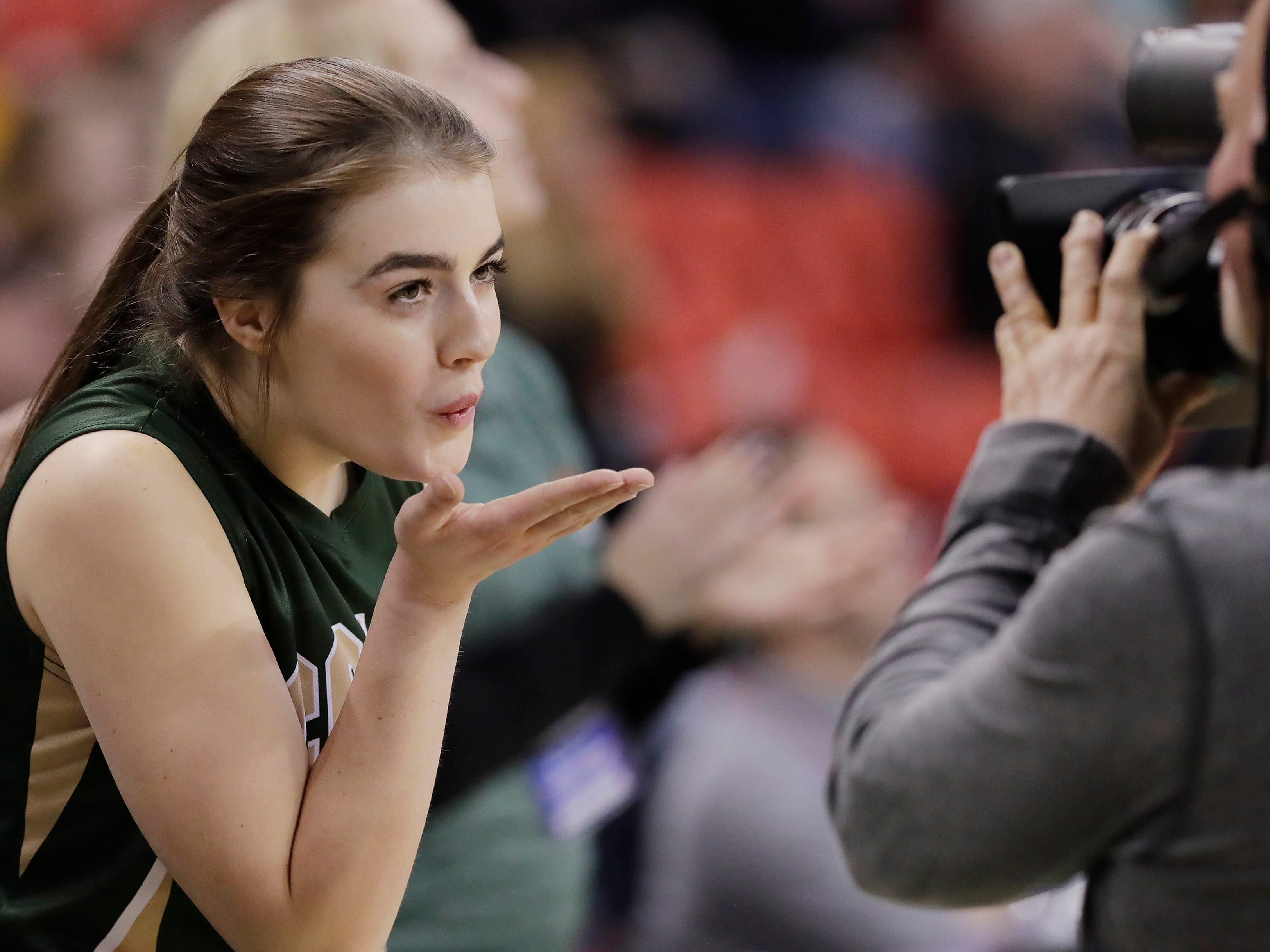 Colby's Lexi Krebsbach (41) blows a kiss at the camera as she is introduced for a Division 3 semifinal at the WIAA state girls basketball tournament at the Resch Center on Thursday, March 7, 2019, in Ashwaubenon, Wis.