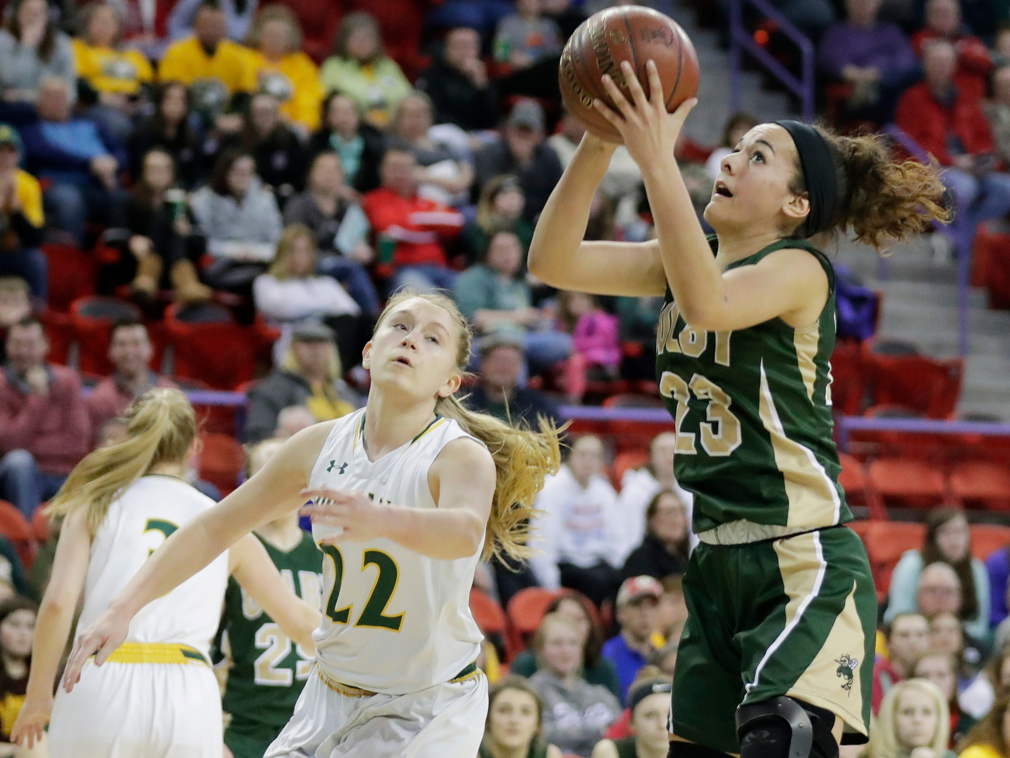 Colby's Vanessa Lopez (23) catches a pass in the paint against Melrose-Mindoro's Erika Simmons (22) in a Division 3 semifinal at the WIAA state girls basketball tournament at the Resch Center on Thursday, March 7, 2019, in Ashwaubenon, Wis.