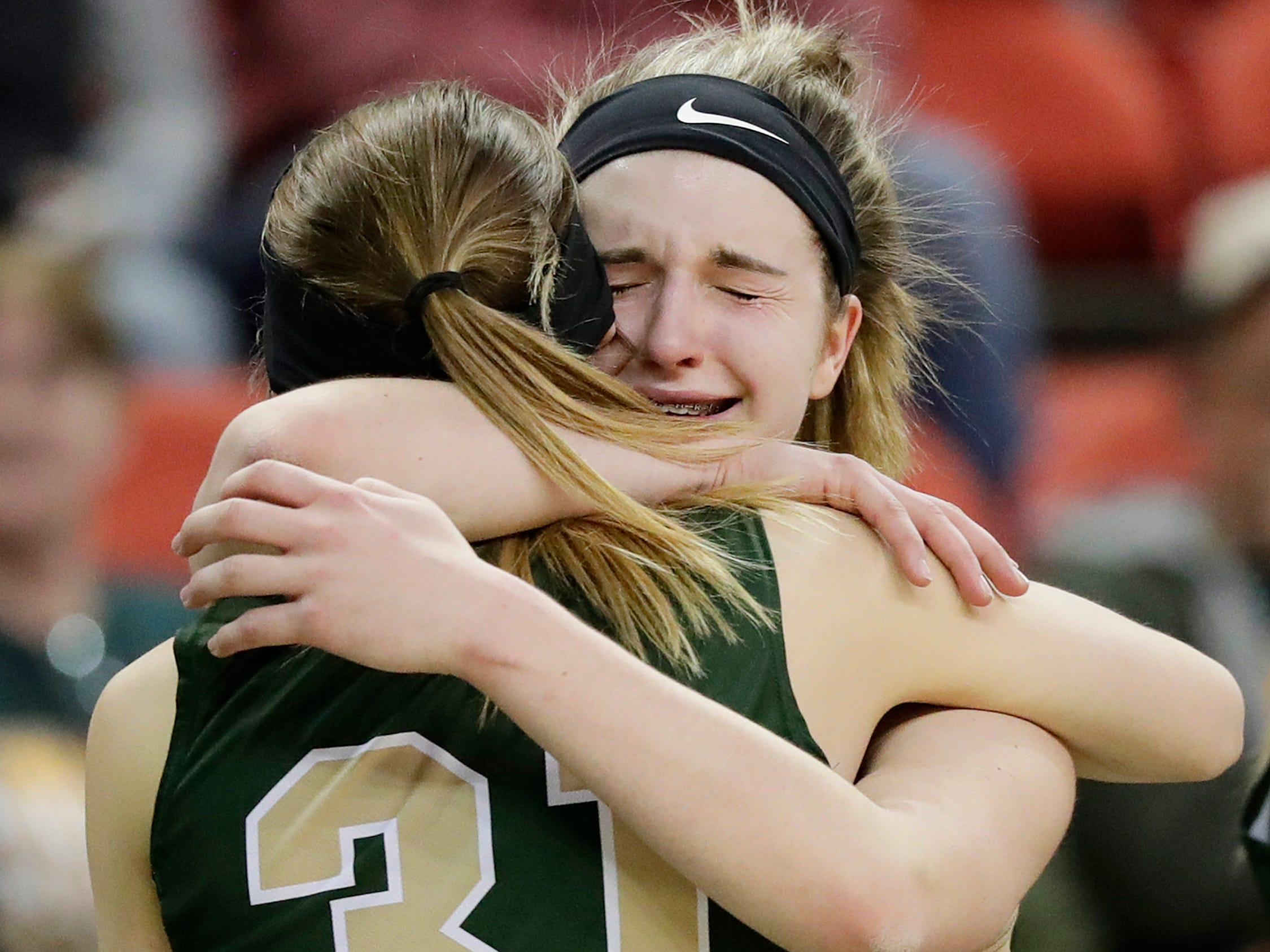 Colby's Alyssa Underwood (31) hugs Colby's Hailey Voelker after being subbed out near the end of a Division 3 semifinal against Melrose-Mindoro at the WIAA state girls basketball tournament at the Resch Center on Thursday, March 7, 2019, in Ashwaubenon, Wis.