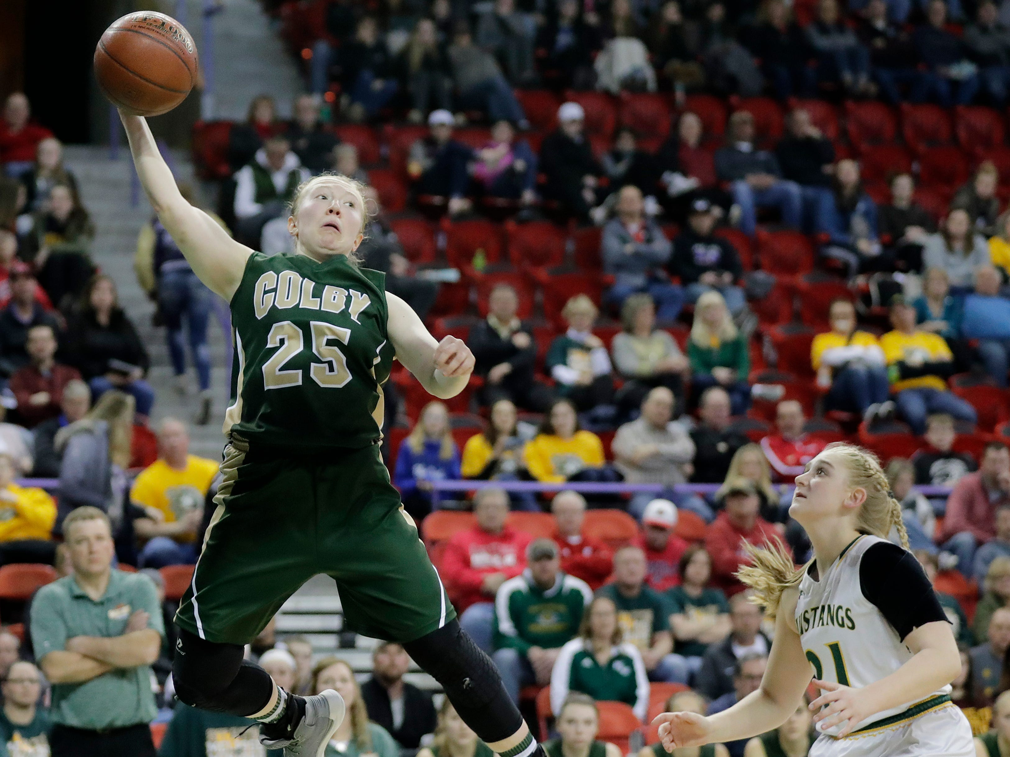 Colby's Ashley Streveler (25) saves the ball from going out of bounds against Melrose-Mindoro in a Division 3 semifinal at the WIAA state girls basketball tournament at the Resch Center on Thursday, March 7, 2019, in Ashwaubenon, Wis.