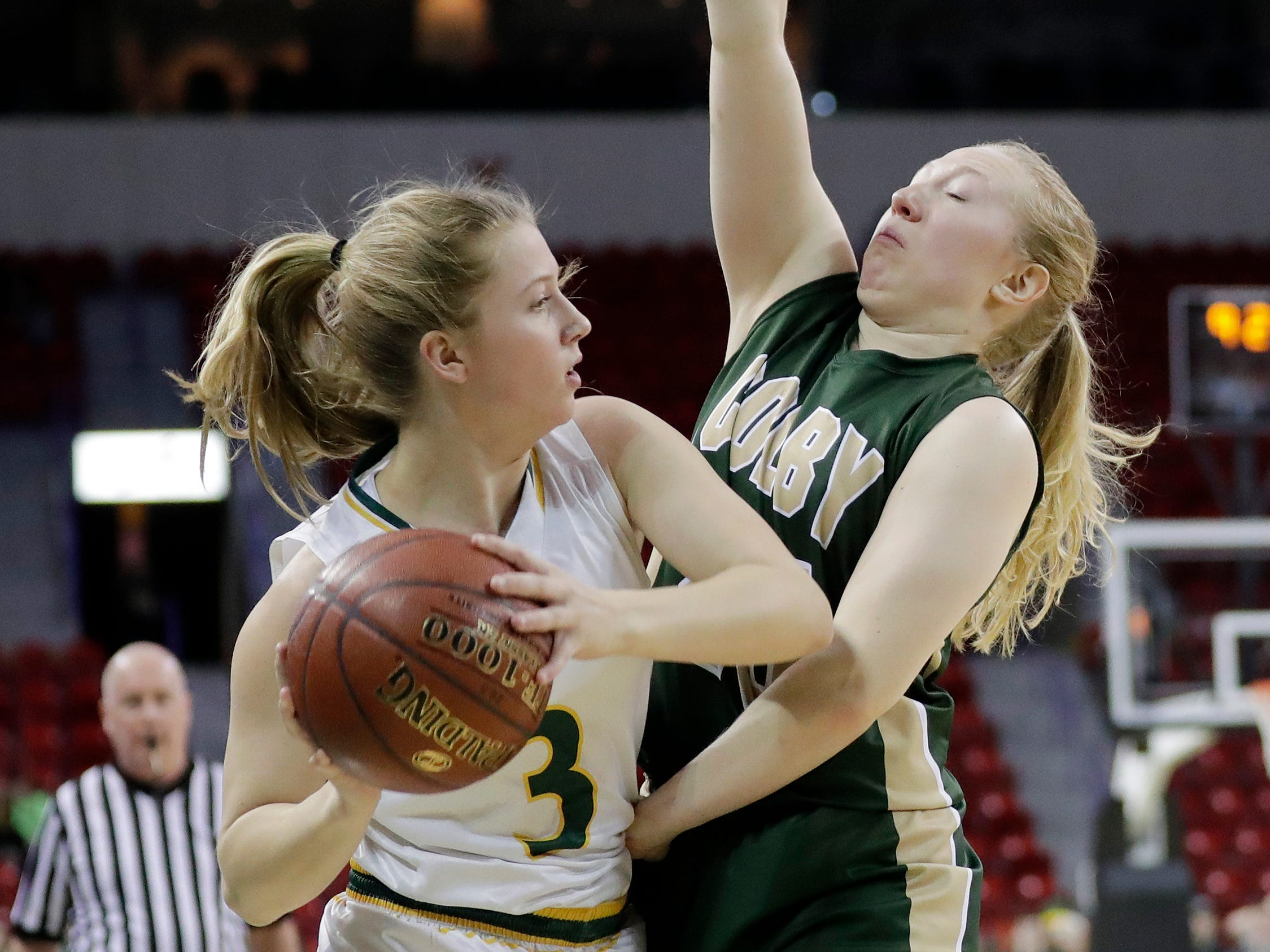Colby's Ashley Streveler (25) guards Melrose-Mindoro's Teagan Frey (3) in a Division 3 semifinal at the WIAA state girls basketball tournament at the Resch Center on Thursday, March 7, 2019, in Ashwaubenon, Wis.