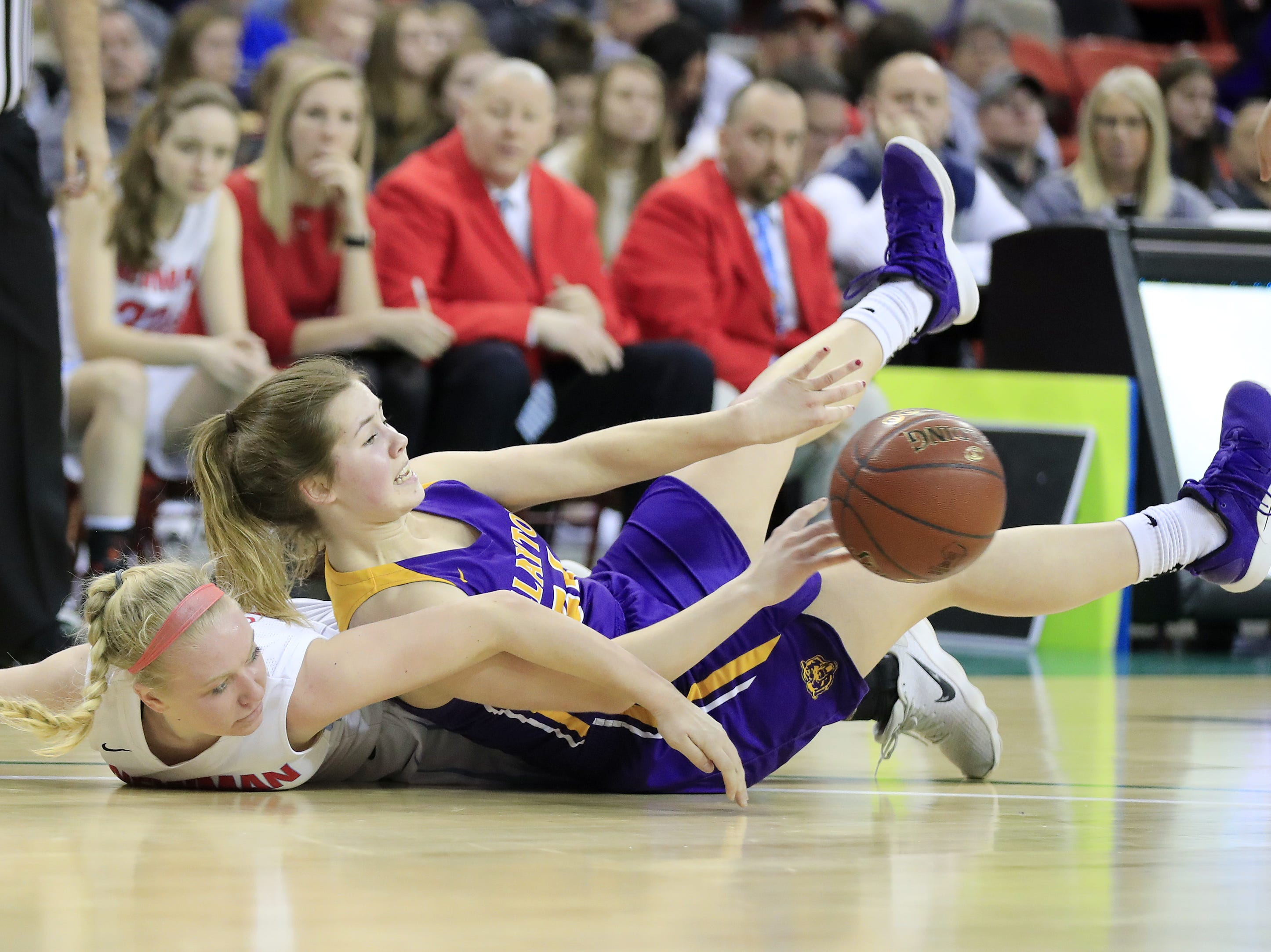 Clayton's Kailey Ketz (right) gets to a loose ball before Wausau Newman Catholic's Mackenzie Krach in a Division 5 semifinal at the WIAA state girls basketball tournament at the Resch Center on Friday, March 8, 2019 in Ashwaubenon, Wis. Adam Wesley/USA TODAY NETWORK-Wisconsin
