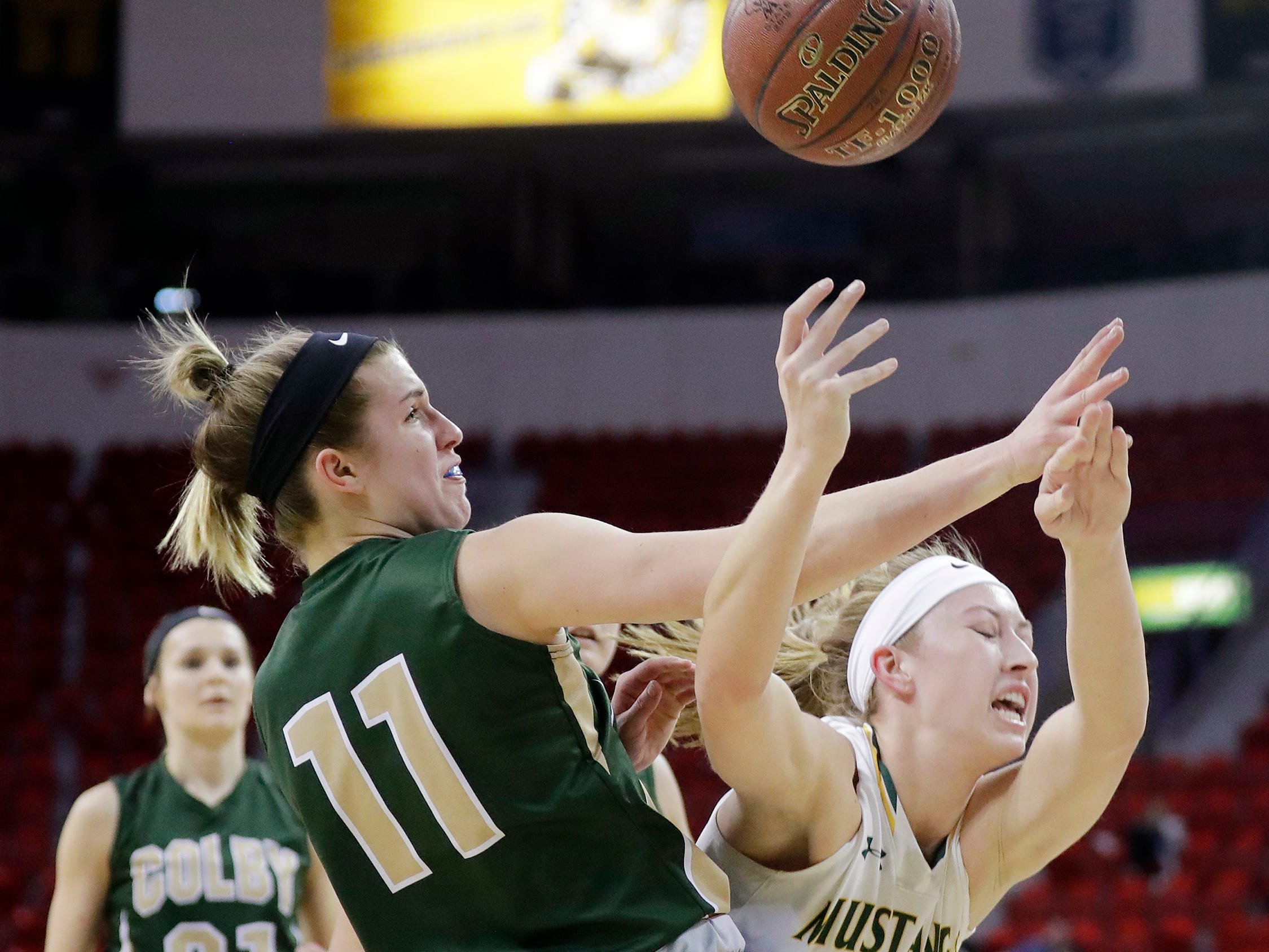 Melrose-Mindoro's Emily Herzberg (40) gets fouled by Colby's Hailey Voelker (11) in a Division 3 semifinal at the WIAA state girls basketball tournament at the Resch Center on Thursday, March 7, 2019, in Ashwaubenon, Wis.