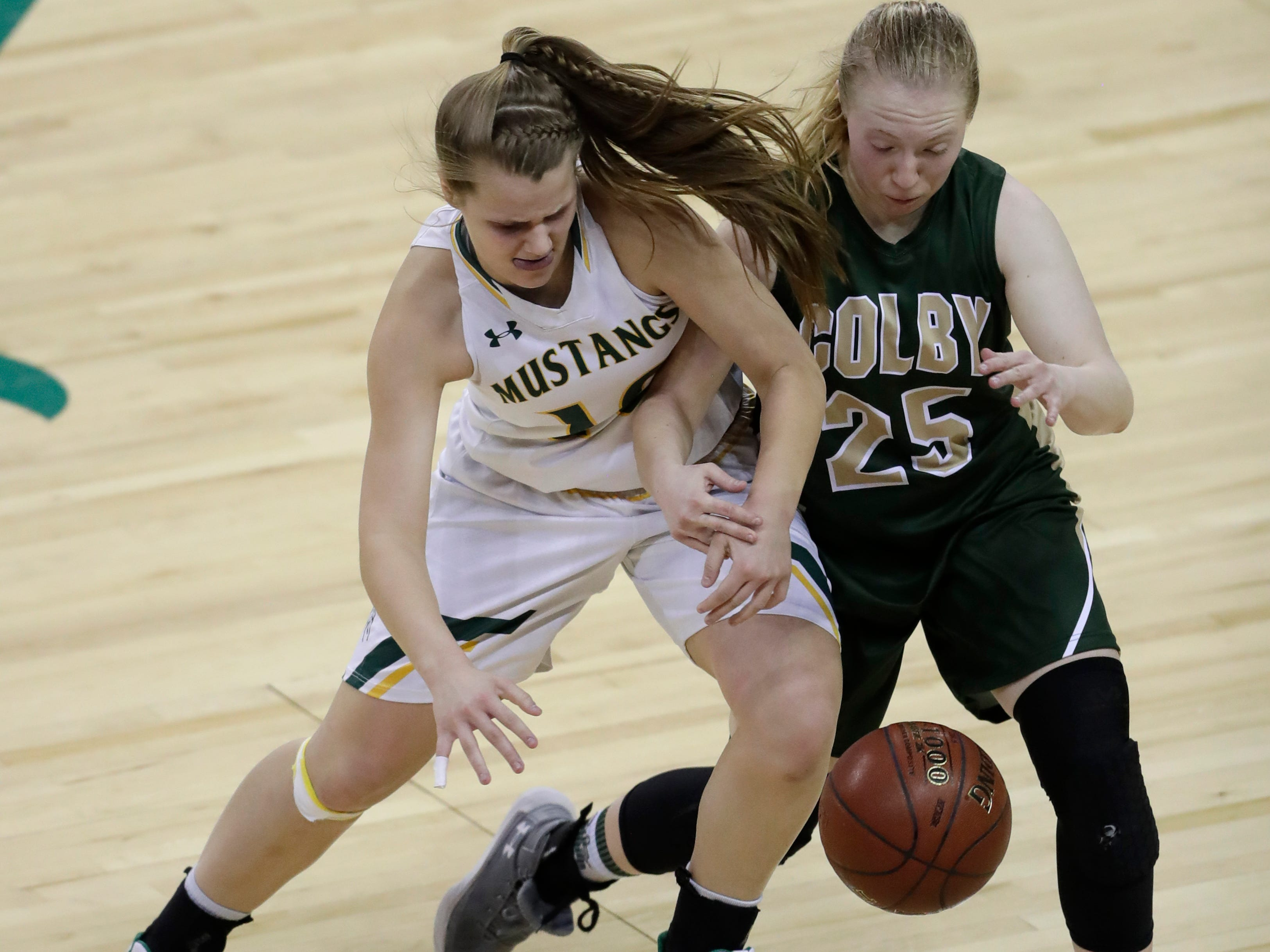 Melrose-Mindoro's Calette Lockington (10) tries to steal the ball from Colby's Ashley Streveler (25) during their Division 4 semifinal game at the WIAA girls state basketball tournament Thursday, March 7, 2019, at the Resch Center in Ashwaubenon, Wis.