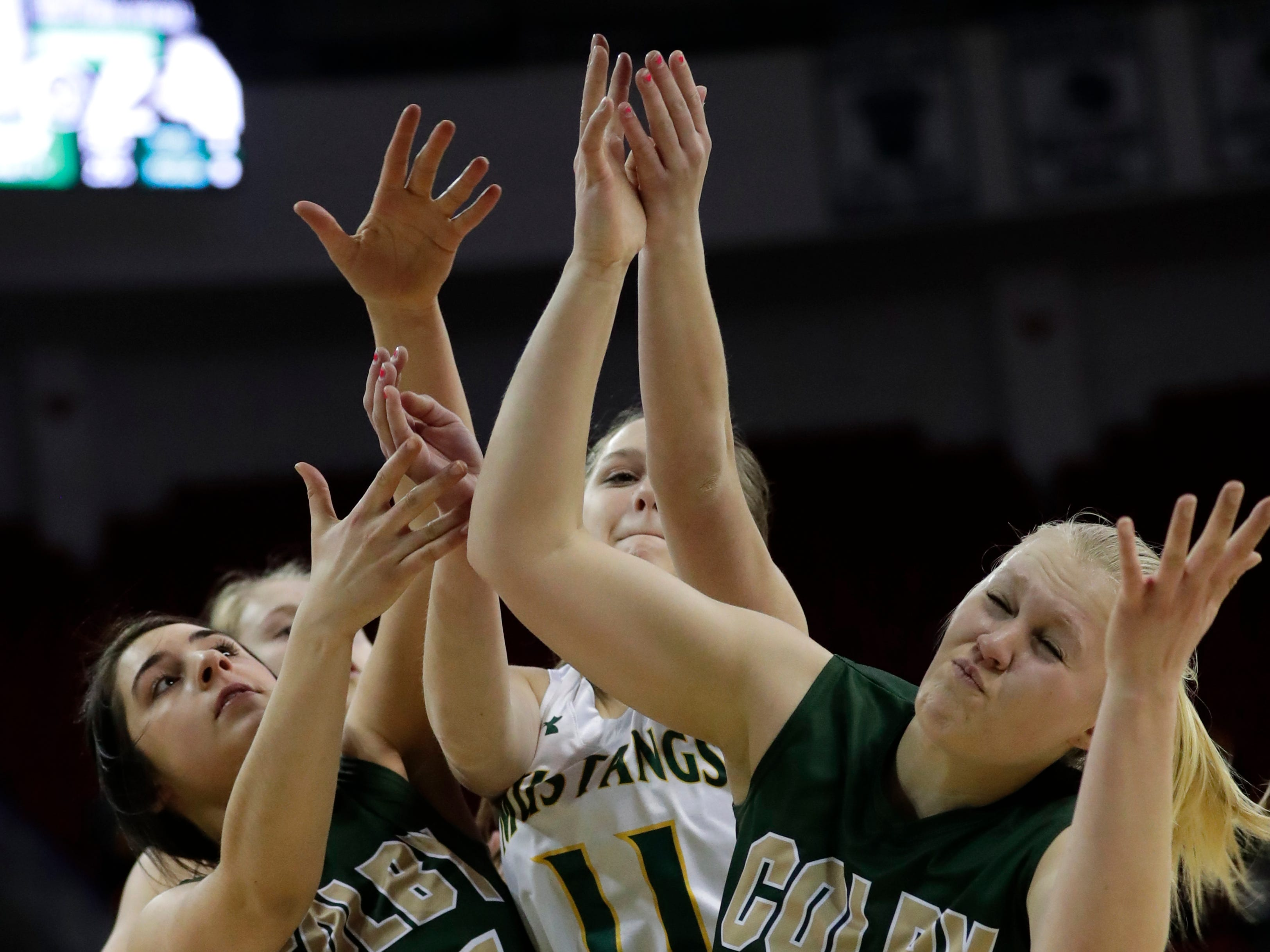 Colby's Mackenzie Seemann (21) and Heather Lynn (33) battle for a rebound against Melrose-Mindoro's Evi Radcliffe (11)during their Division 4 semifinal game at the WIAA girls state basketball tournament Thursday, March 7, 2019, at the Resch Center in Ashwaubenon, Wis.