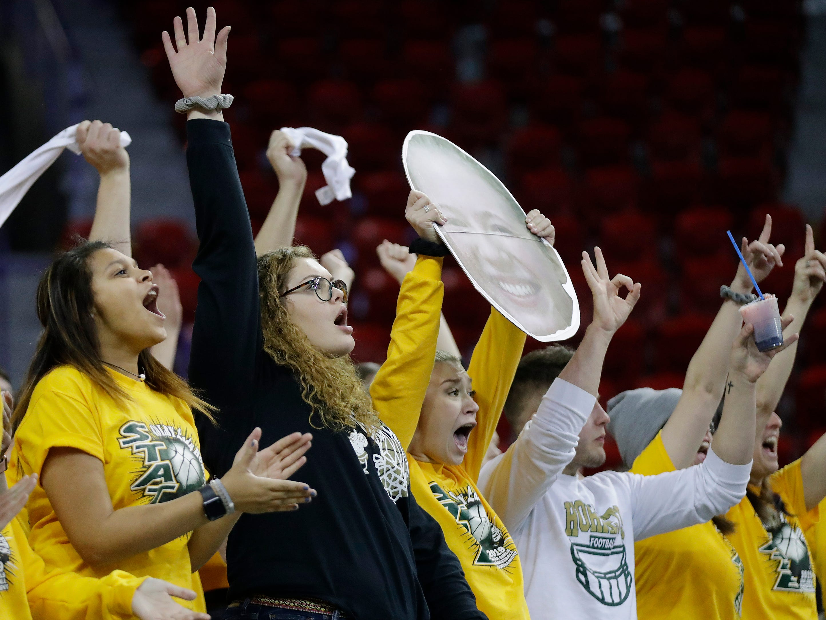 Colby fans cheer after a three-point basket against Melrose-Mindoro a Division 3 semifinal at the WIAA state girls basketball tournament at the Resch Center on Thursday, March 7, 2019, in Ashwaubenon, Wis.