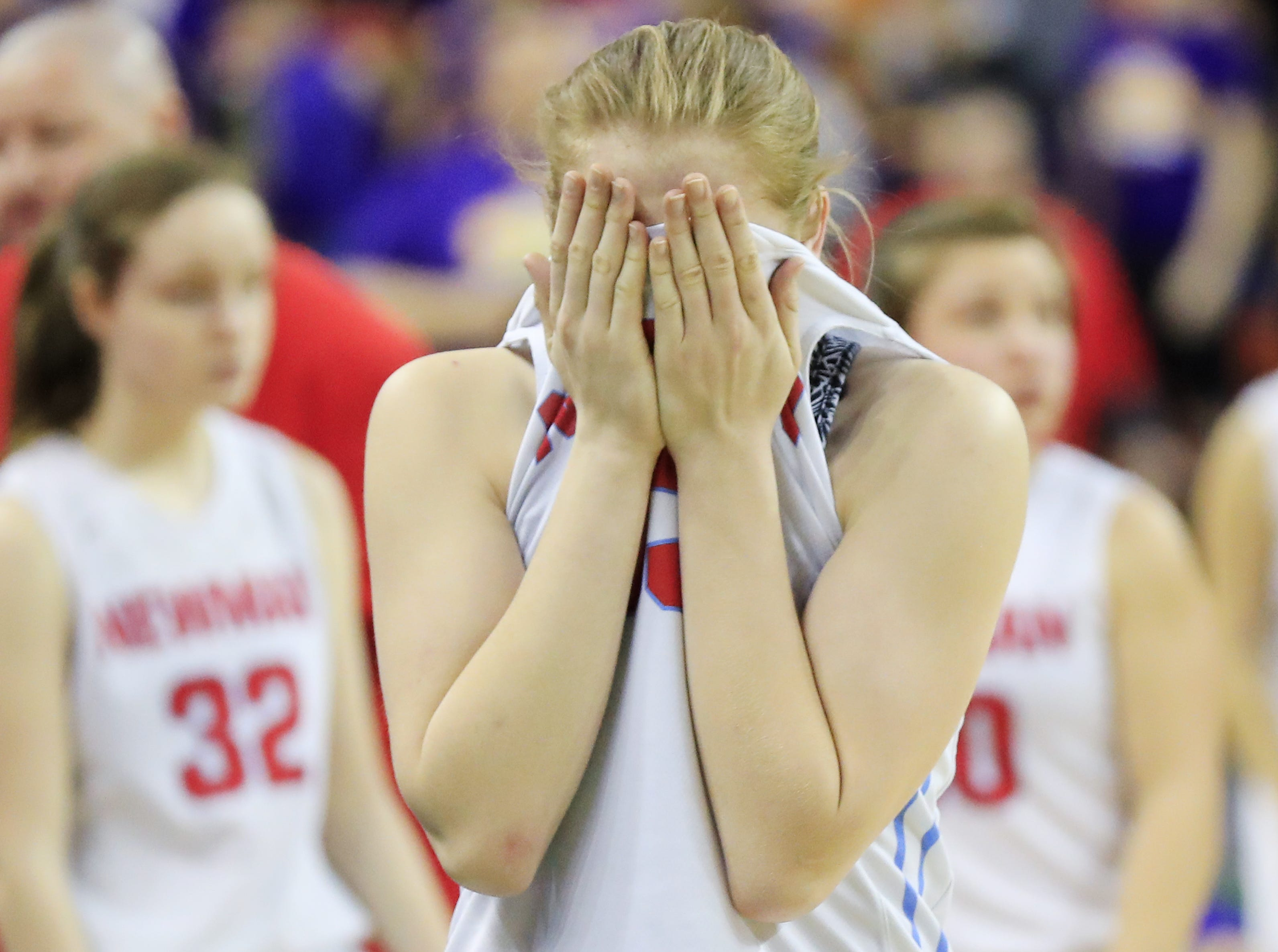 Wausau Newman Catholic's Jadelyn Ganski (33) reacts after the Cardinals lost to Clayton in a Division 5 semifinal at the WIAA state girls basketball tournament at the Resch Center on Friday, March 8, 2019 in Ashwaubenon, Wis. Adam Wesley/USA TODAY NETWORK-Wisconsin
