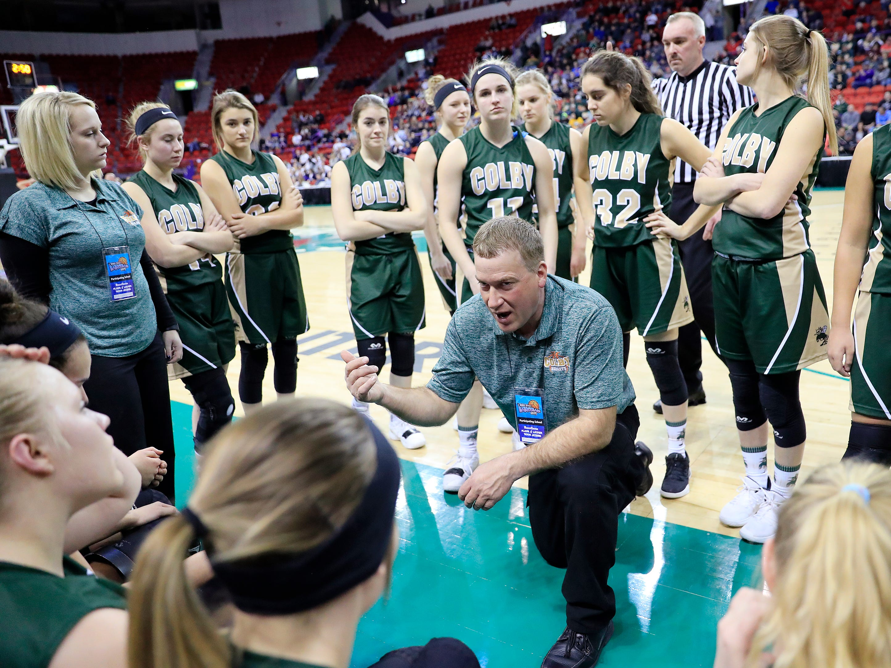 Colby head coach Randy Rau talks to his team in a pregame huddle before a Division 3 semifinal at the WIAA state girls basketball tournament at the Resch Center on Thursday, March 7, 2019, in Ashwaubenon, Wis.