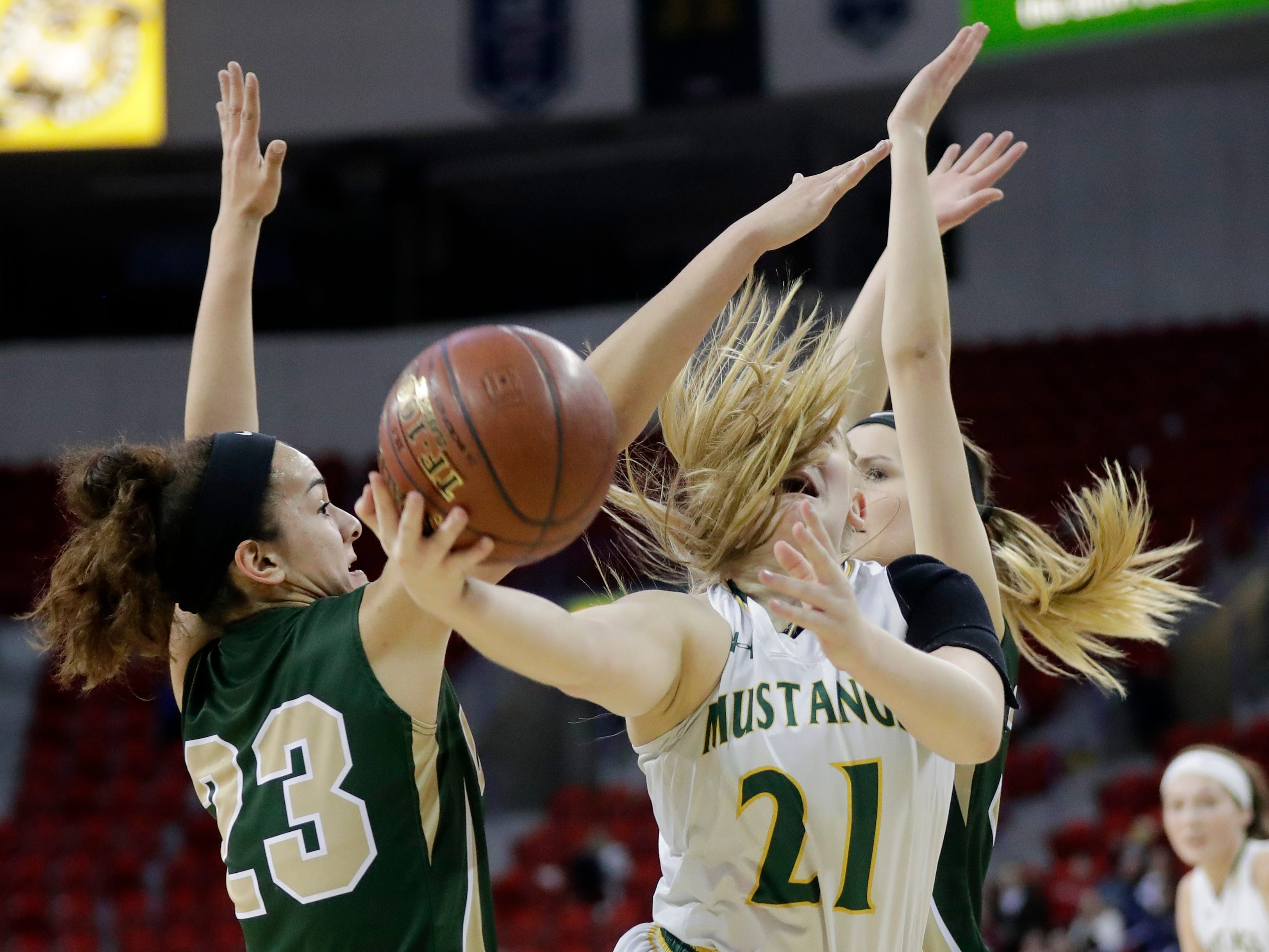 Melrose-Mindoro's Katie Christopherson (21) gets fouled by Colby's Vanessa Lopez (23) in a Division 3 semifinal at the WIAA state girls basketball tournament at the Resch Center on Thursday, March 7, 2019, in Ashwaubenon, Wis.