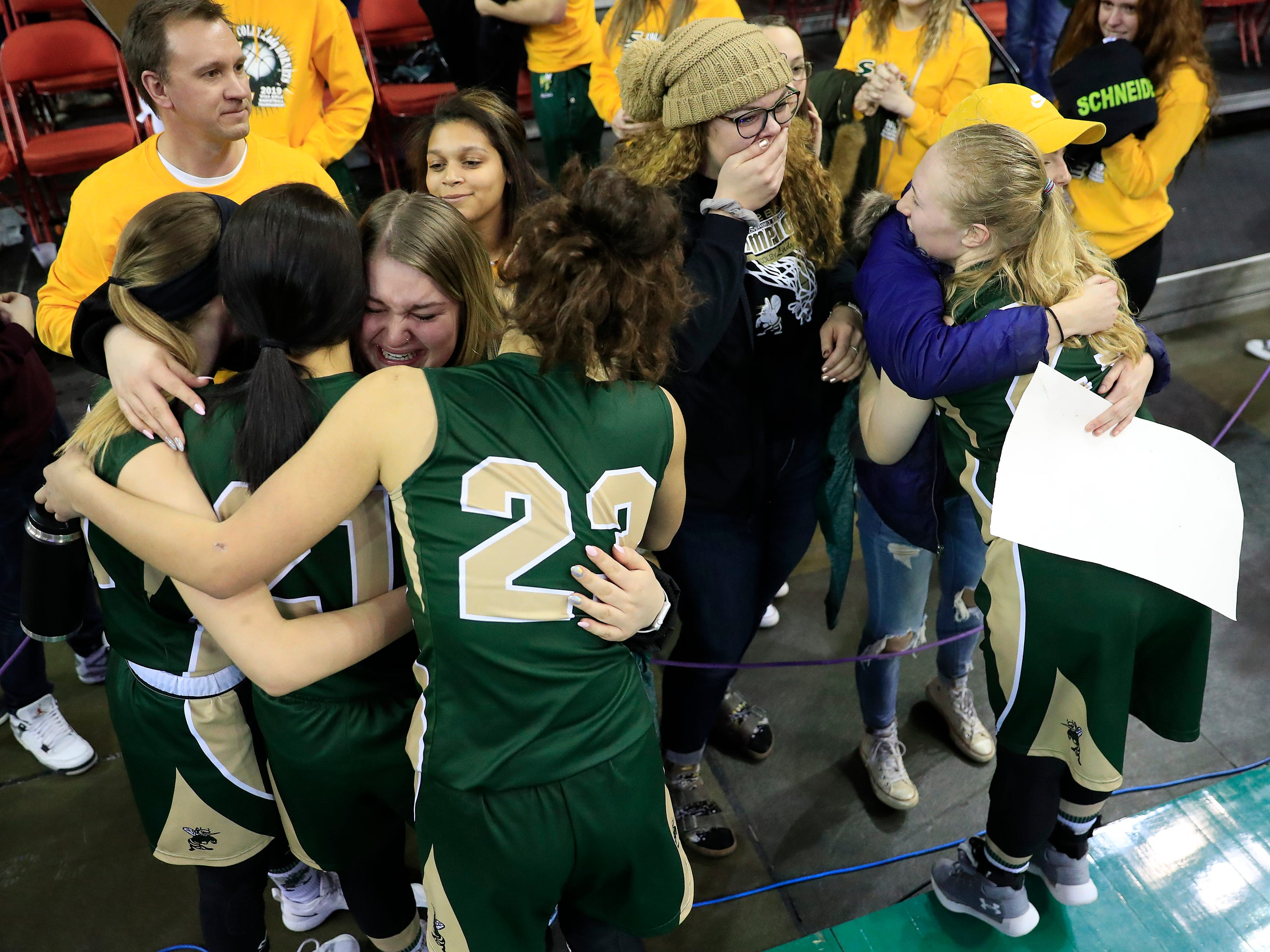 Colby players hug their supporters after losing to Melrose-Mindoro in a Division 3 semifinal at the WIAA state girls basketball tournament at the Resch Center on Thursday, March 7, 2019, in Ashwaubenon, Wis.