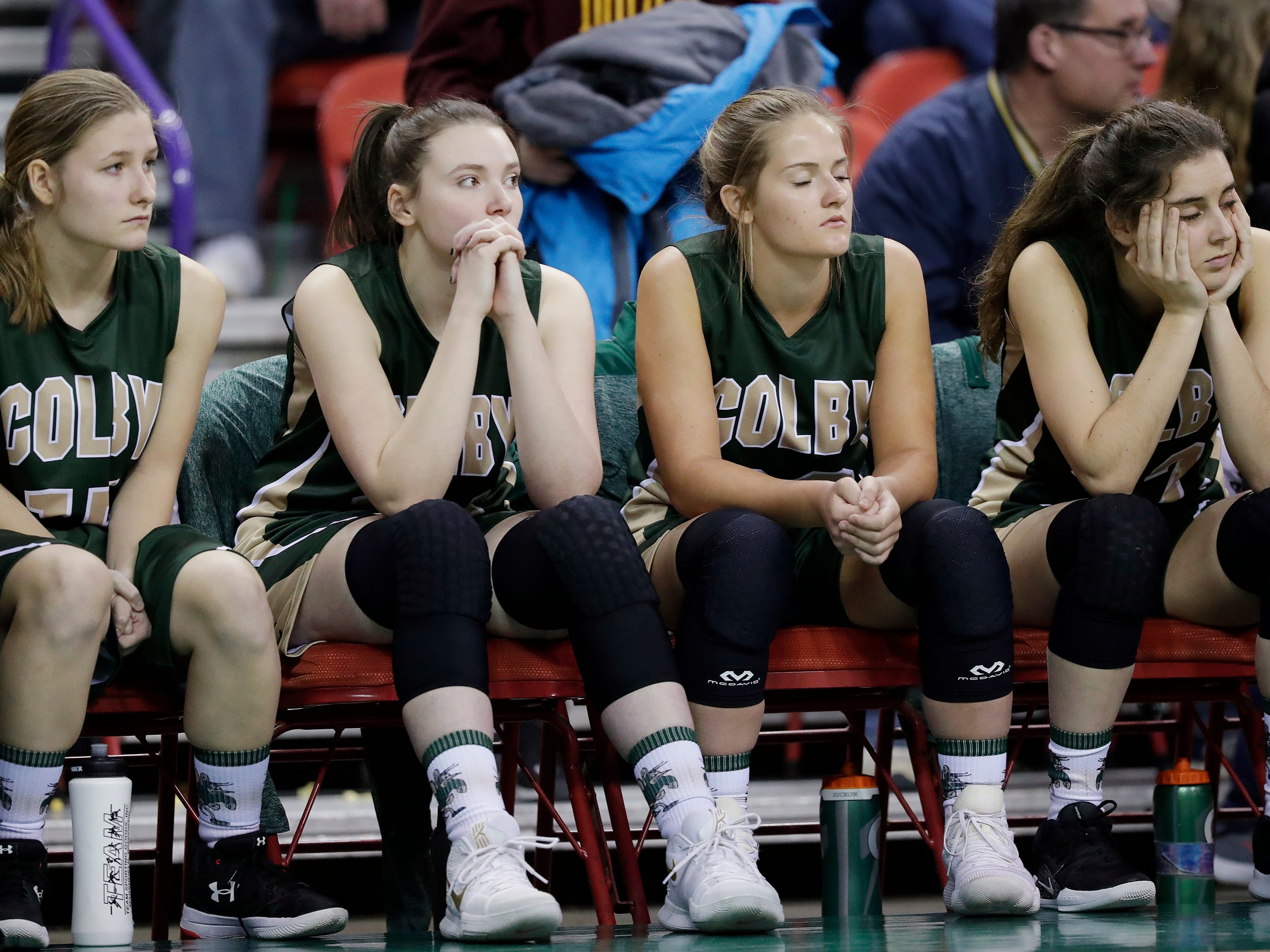 Colby players watch the final minutes of their Division 3 semifinal against Melrose-Mindoro at the WIAA state girls basketball tournament at the Resch Center on Thursday, March 7, 2019, in Ashwaubenon, Wis.