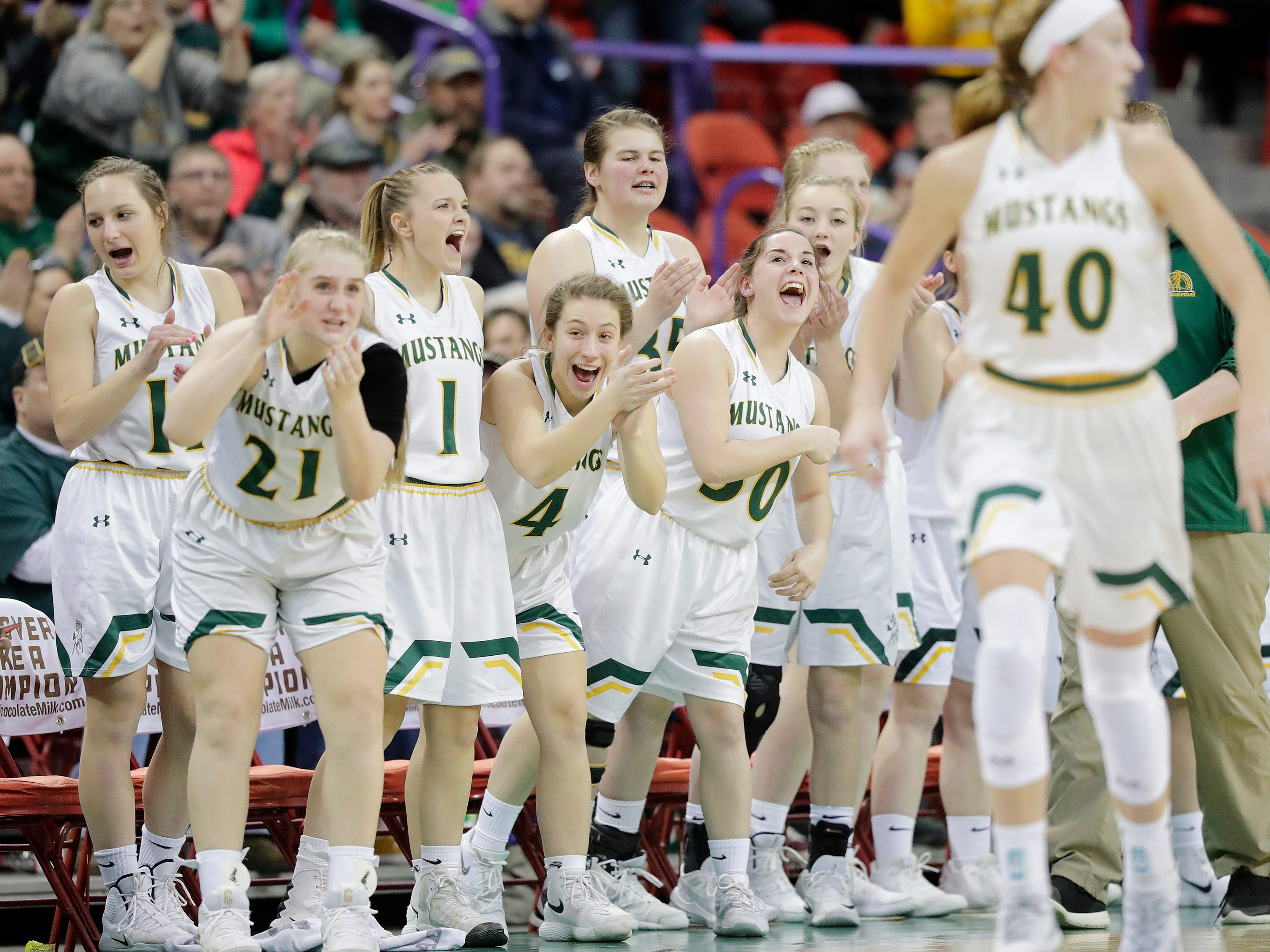 Melrose-Mindoro players celebrate a three against Colby in a Division 3 semifinal at the WIAA state girls basketball tournament at the Resch Center on Thursday, March 7, 2019, in Ashwaubenon, Wis.