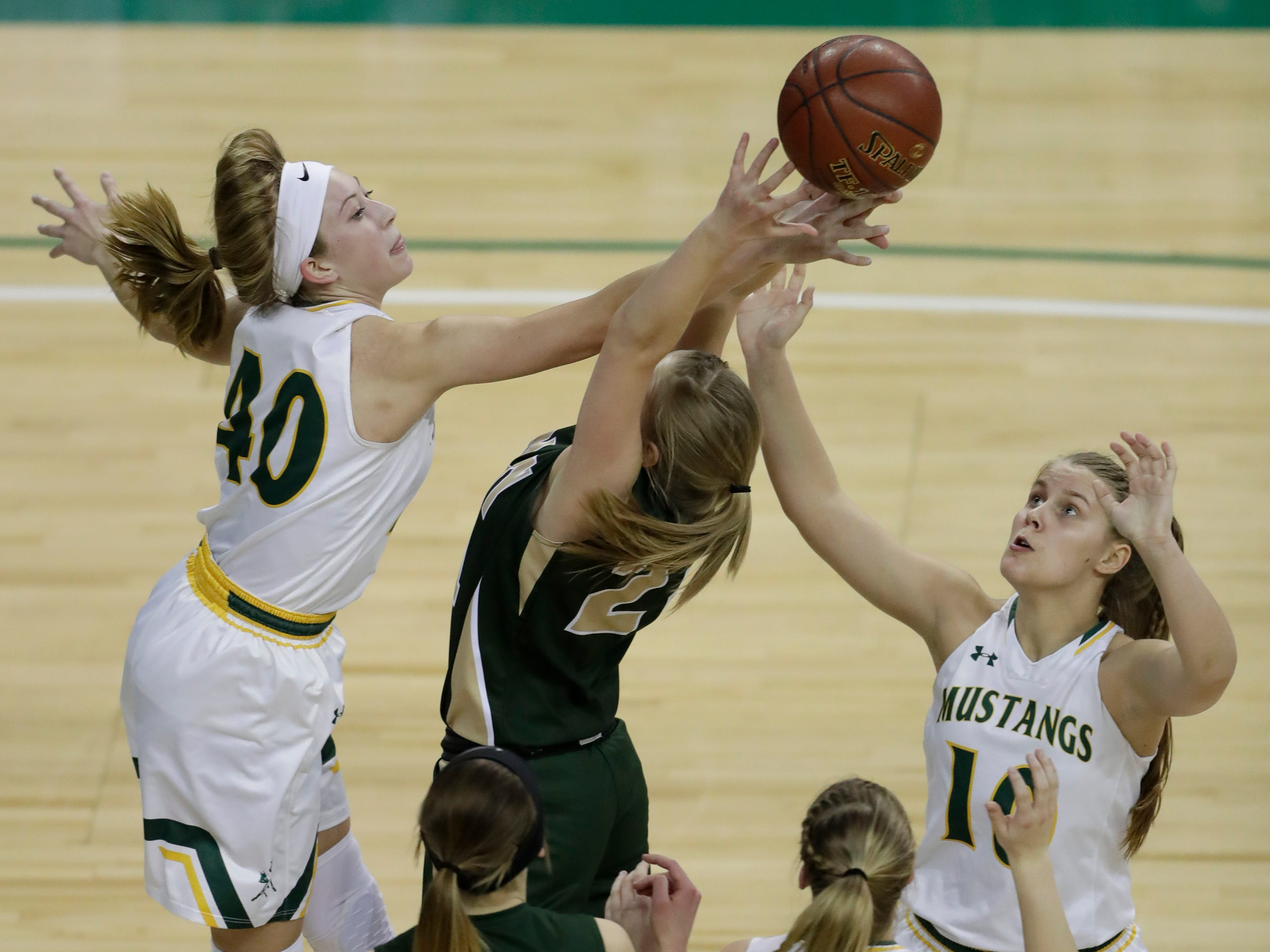 Melrose-Mindoro's Emily Herzberg (40) and Calette Lockington (10) battle for a rebound against Colby's Lexi Underwood (24) during their Division 4 semifinal game at the WIAA girls state basketball tournament Thursday, March 7, 2019, at the Resch Center in Ashwaubenon, Wis.