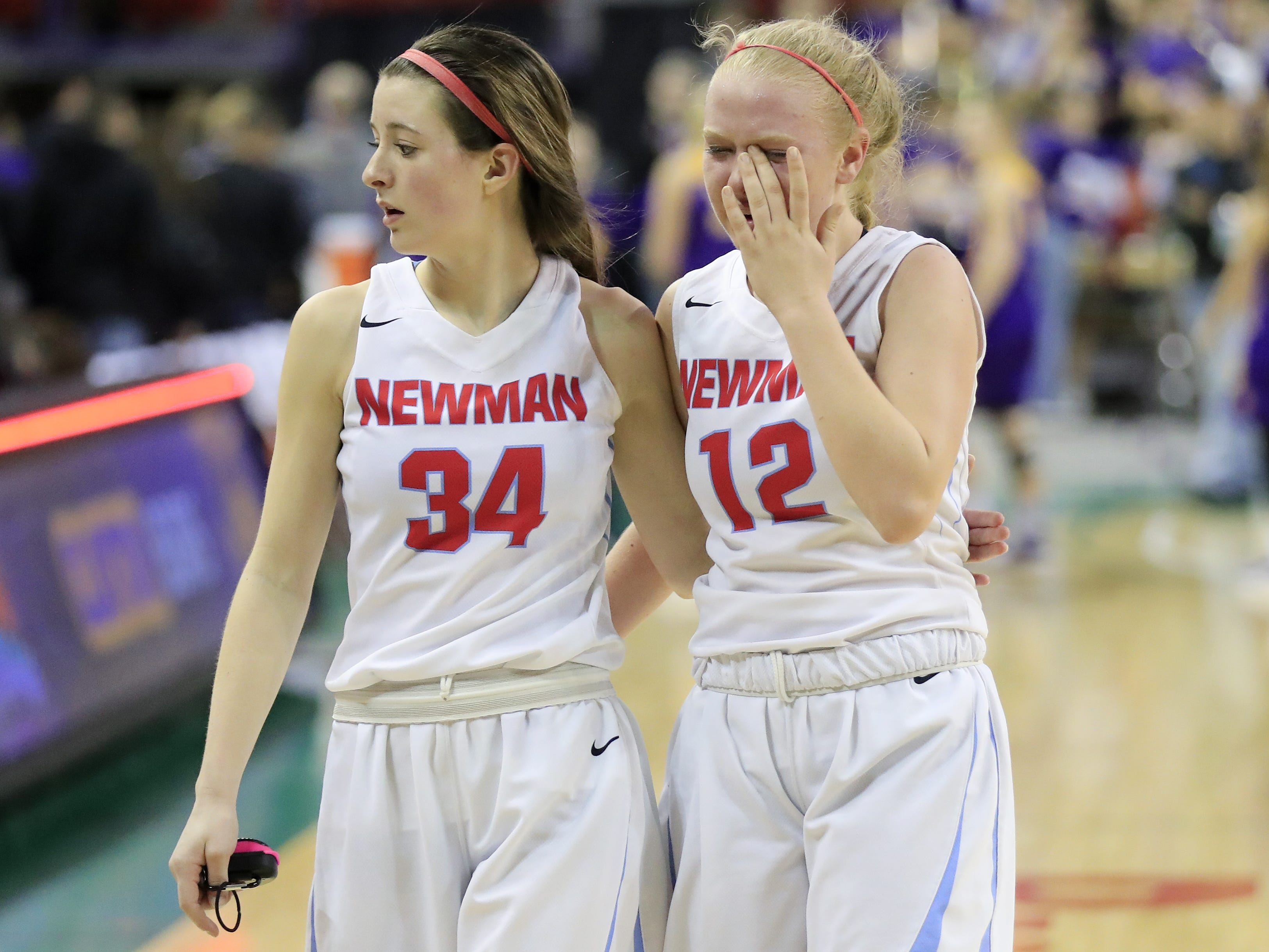Wausau Newman Catholic's Julia Seidel (34) and Mackenzie Krach (12) walk off the court after the Cardinals lost to Clayton in a Division 5 semifinal at the WIAA state girls basketball tournament at the Resch Center on Friday, March 8, 2019 in Ashwaubenon, Wis. Adam Wesley/USA TODAY NETWORK-Wisconsin
