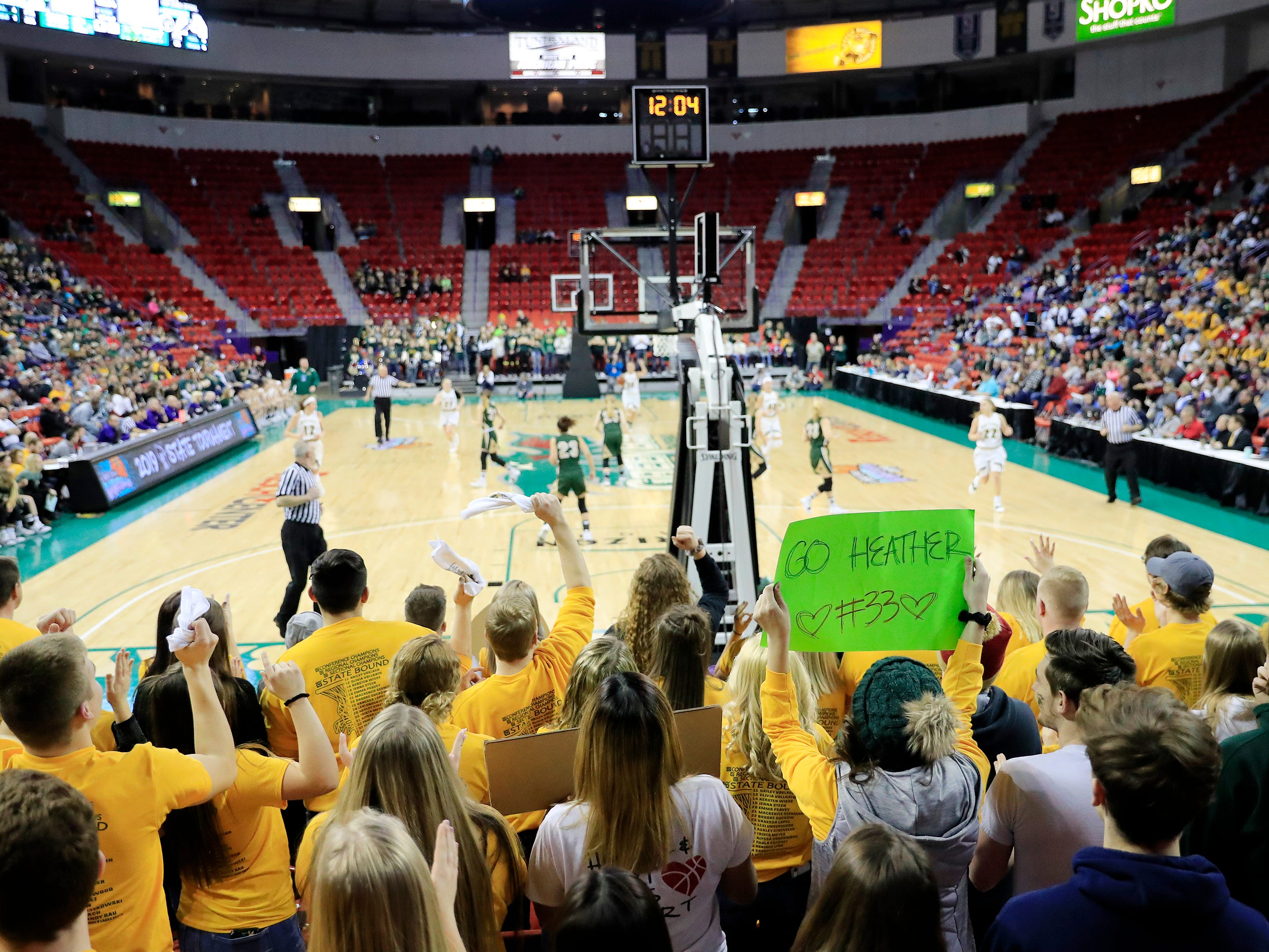 Colby fans cheer in a Division 3 semifinal at the WIAA state girls basketball tournament at the Resch Center on Thursday, March 7, 2019, in Ashwaubenon, Wis.