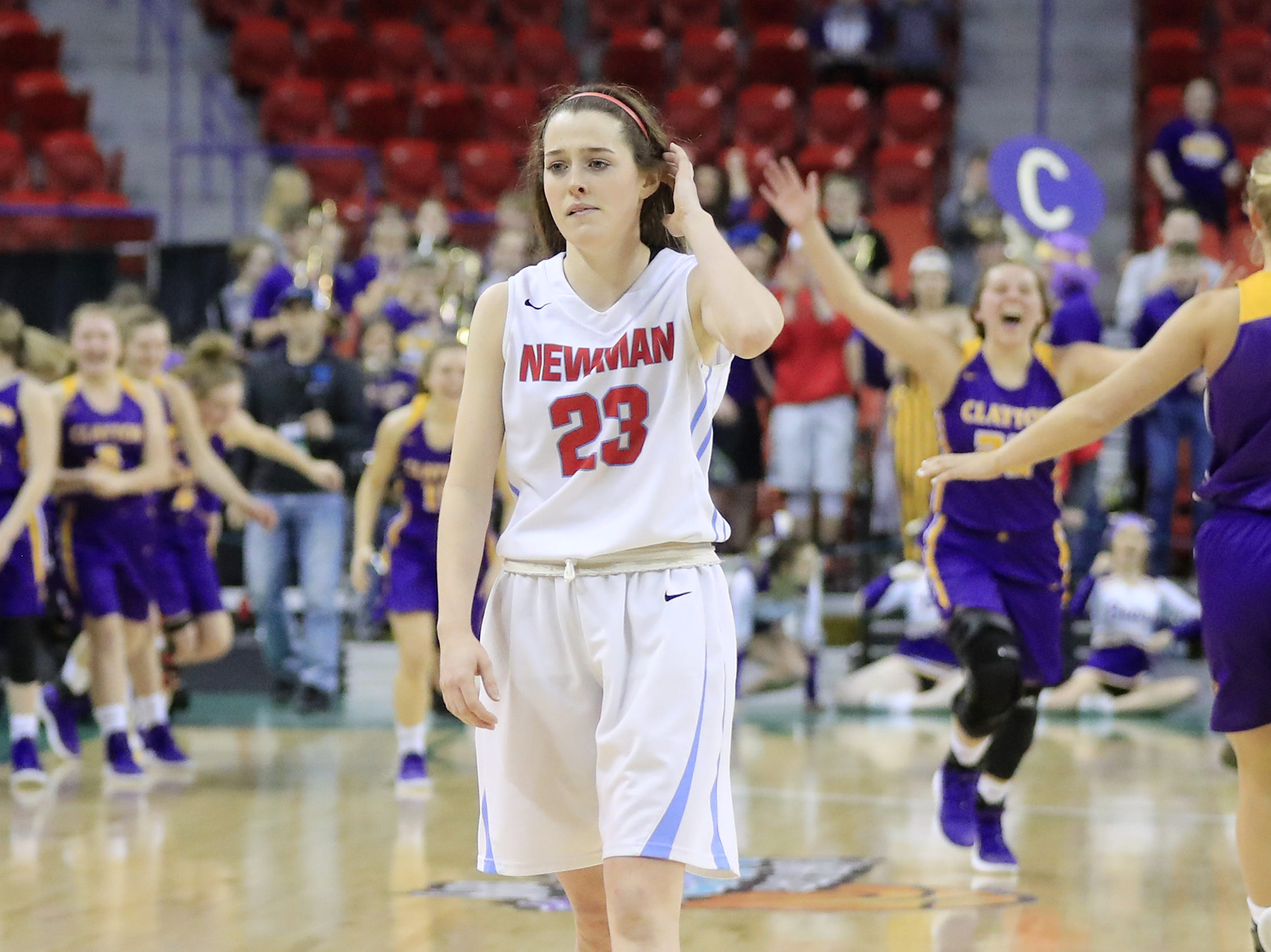 Wausau Newman Catholic's Lauren Shields (23) walks off the court after the Cardinals lost to Clayton in a Division 5 semifinal at the WIAA state girls basketball tournament at the Resch Center on Friday, March 8, 2019 in Ashwaubenon, Wis. Adam Wesley/USA TODAY NETWORK-Wisconsin