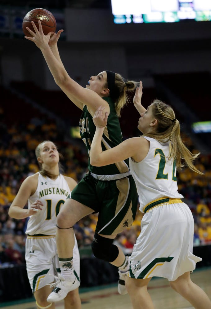 Colby's Hailey Voelker (11) looks to score against Melrose-Mindoro's Erika Simmons (22) during their Division 4 semifinal game at the WIAA girls state basketball tournament Thursday, March 7, 2019, at the Resch Center in Ashwaubenon, Wis.