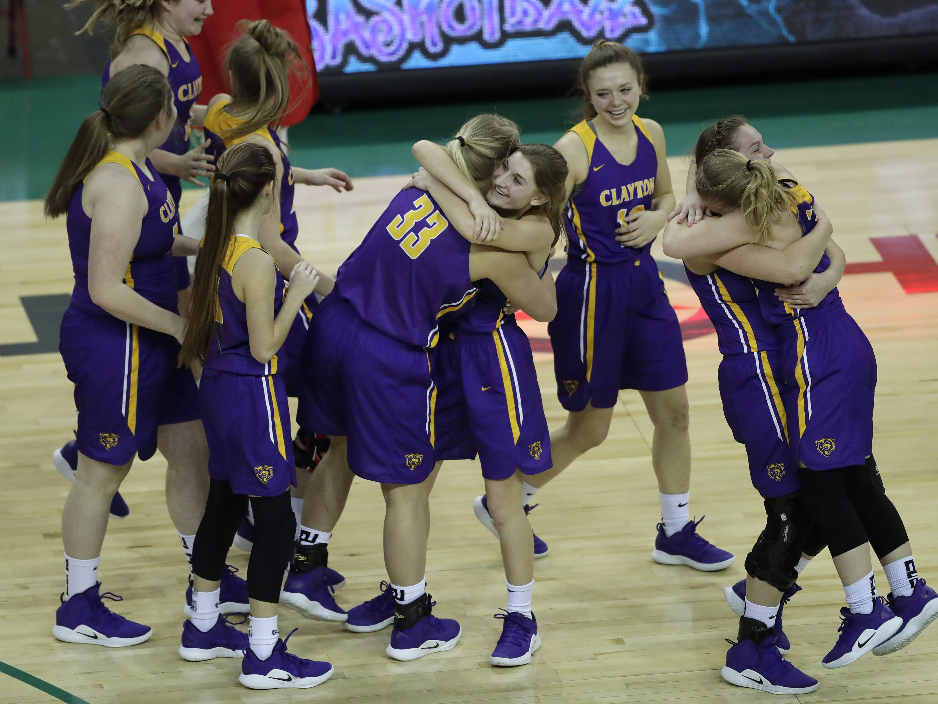 Clayton celebrates their victory against Wausau Newman Catholic during their Division 5 semifinal game at the WIAA girls state basketball tournament Friday, March 8, 2019, at the Resch Center in Ashwaubenon, Wis.  Dan Powers/USA TODAY NETWORK-Wisconsin
