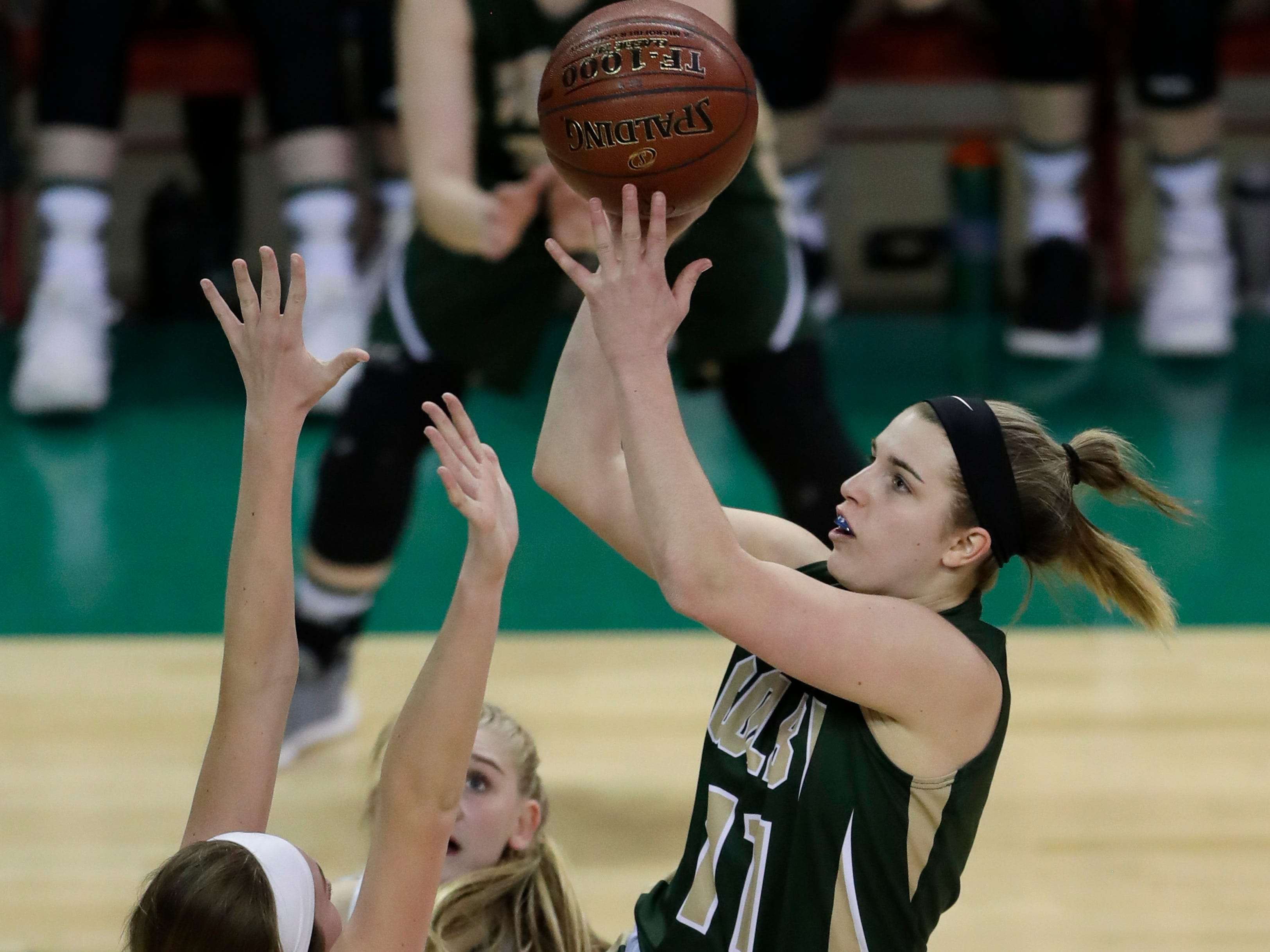 Colby's Hailey Voelker (11) shoots against Melrose-Mindoro's Mesa Byom (12) during their Division 4 semifinal game at the WIAA girls state basketball tournament Thursday, March 7, 2019, at the Resch Center in Ashwaubenon, Wis.