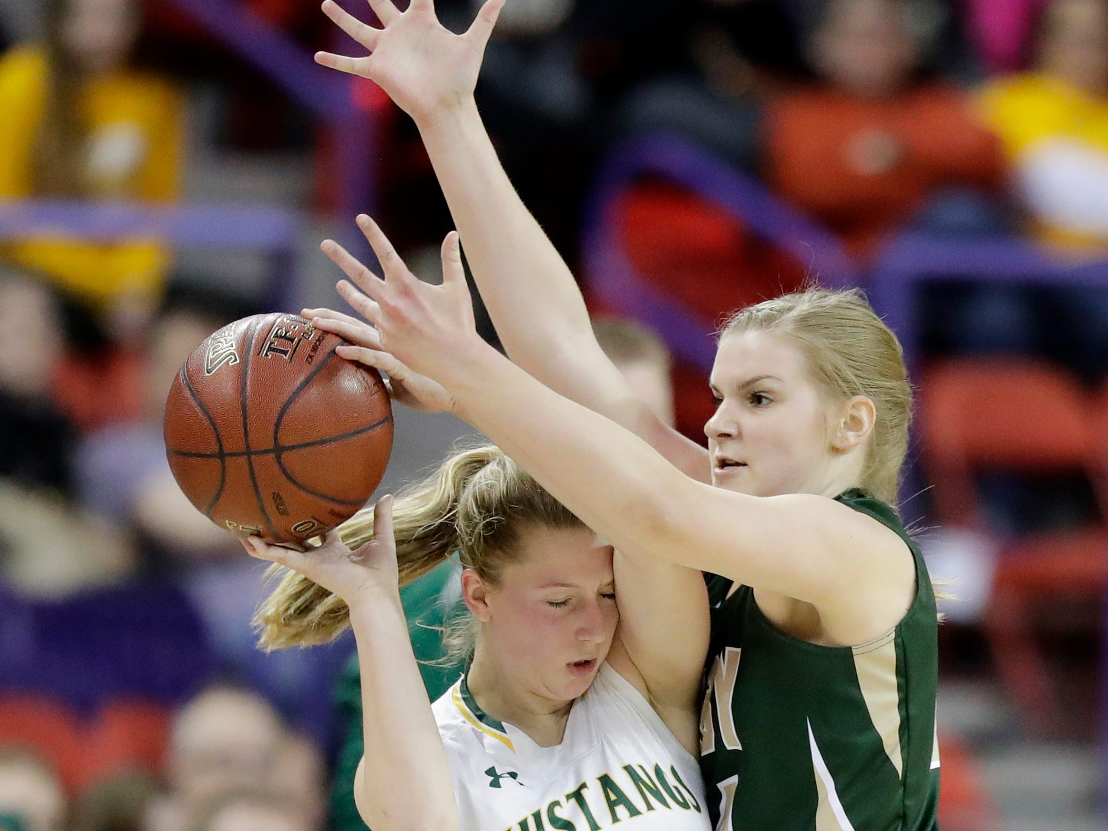 Colby's Lexi Underwood (24) pressures Melrose-Mindoro's Teagan Frey (3) in a Division 3 semifinal at the WIAA state girls basketball tournament at the Resch Center on Thursday, March 7, 2019, in Ashwaubenon, Wis.