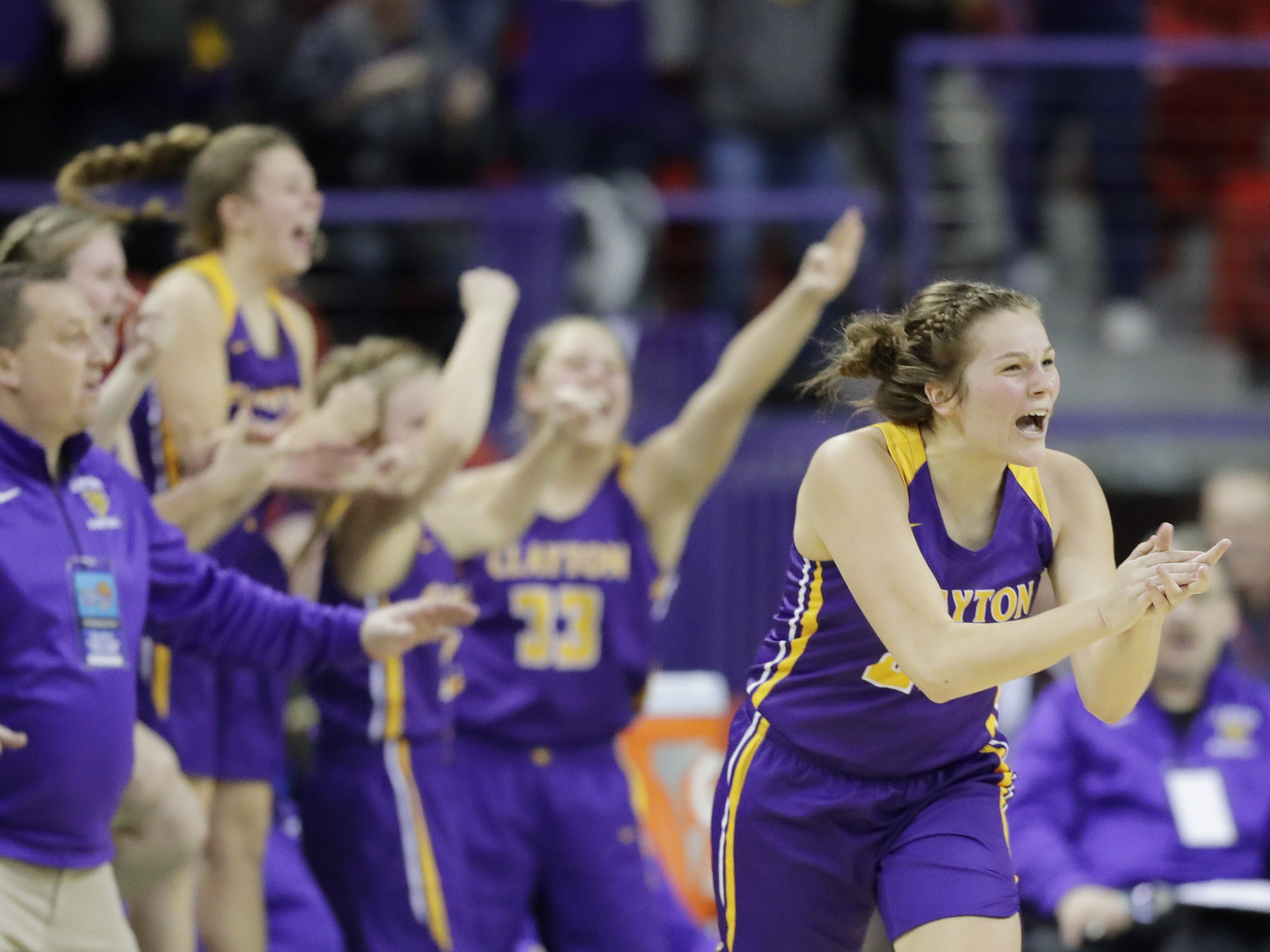 Clayton's Alison Leslie (23) celebrates after hitting a three-pointer against Wausau Newman in a Division 5 semifinal at the WIAA state girls basketball tournament at the Resch Center on Friday, March 8, 2019 in Ashwaubenon, Wis. Adam Wesley/USA TODAY NETWORK-Wisconsin