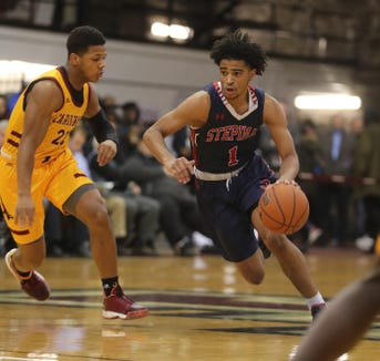 RJ Davis of Stepinac drives on Jalen Smith of Cardinal Hayes during a CHSAA semifinal basketball game at Fordham University March 7, 2019. Stepinac defeated Cardinal Hayes 77-65.