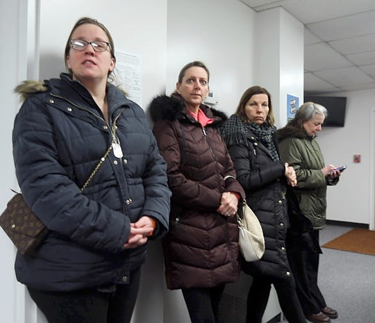Trisha Lanesa, K-2nd Instructional Facilitator, left, along with other parents and teachers rushed to school board meeting when they heard Suffern Central School District board voted to suspend Superintendent Douglas Adams during the school board meeting in Hilburn March 7, 2019.