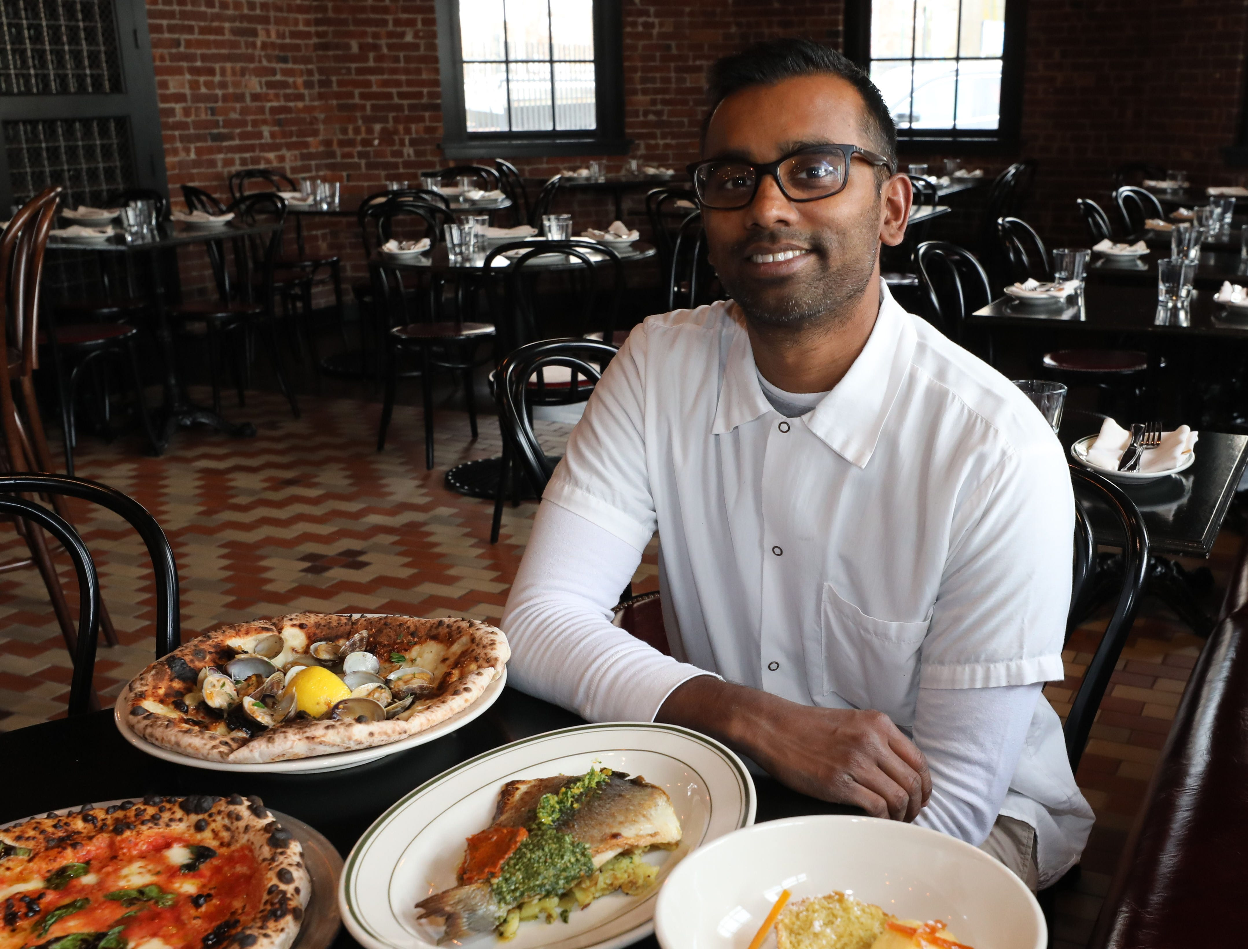 Executive Chef Mogan Anthony from Village Social Restaurant Group, is pictured with some of the food at Locali Pizza Bar and Kitchen in the Mount Kisco, March 8, 2019.