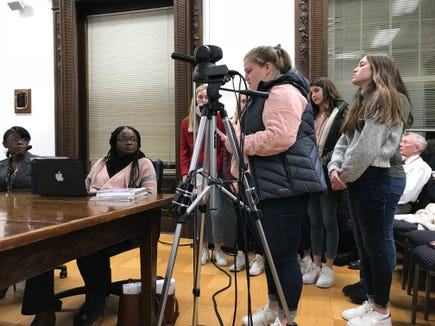Sleepy Hollow girls basketball player Emma Briante speaks at a Board of Education meeting with teammates in support of fired assistant coach Ryan Fischer. Mar. 7, 2019.