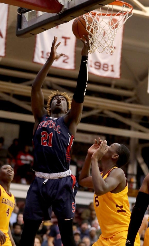 Adrian Griffin, Jr. of Stepinac goes to the basket against Cardinal Hayes during a CHSAA semifinal basketball game at Fordham University March 7, 2019. Stepinac defeated Cardinal Hayes 77-65.