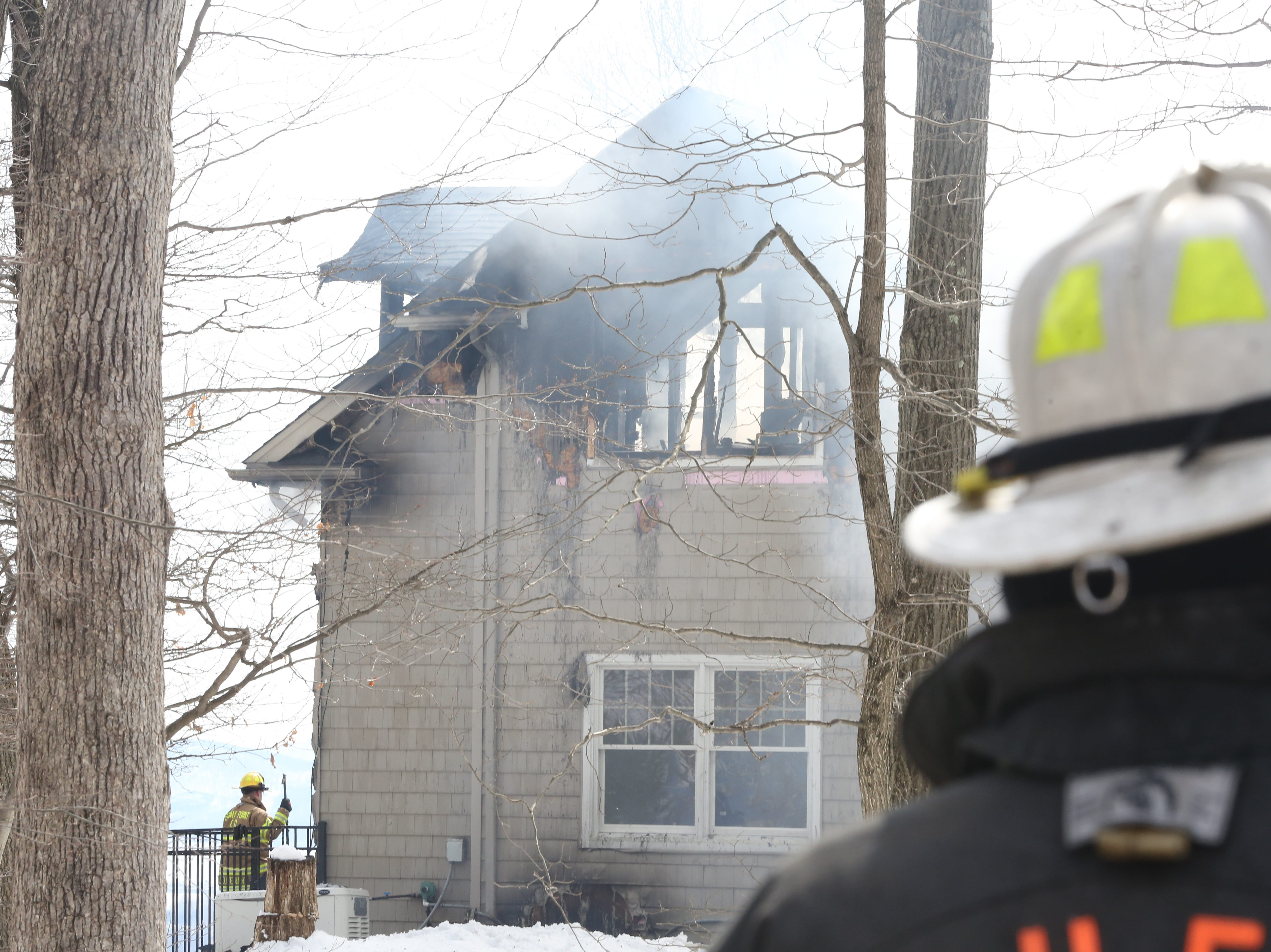 Firefighters battle a house fire on Soluri Lane in Tomkins Cove on March 8, 2019.