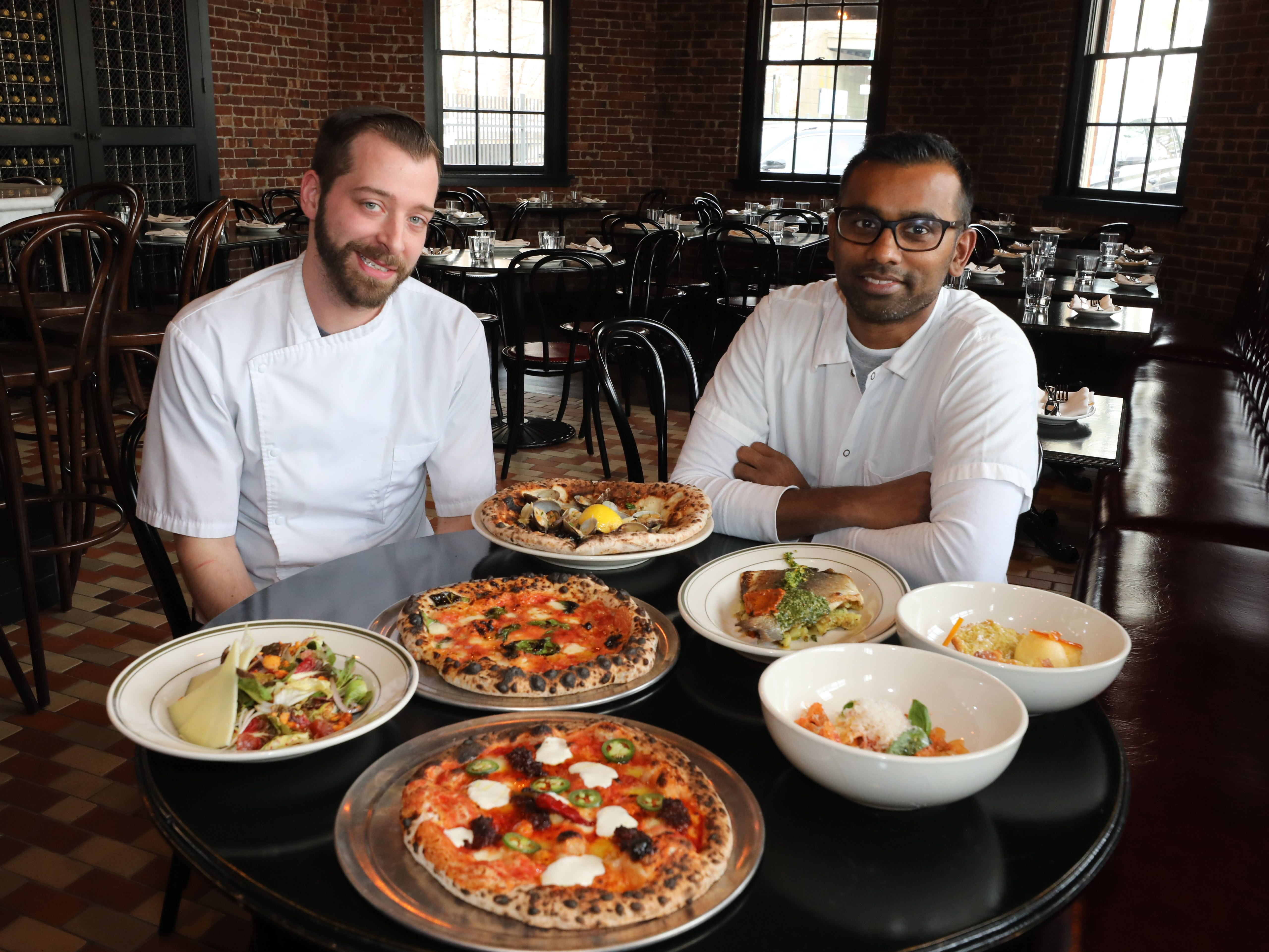 Executive Chef William Eschner and Executive Chef Mogan Anthony from Village Social Restaurant Group are pictured with some of their food at Locali Pizza Bar and Kitchen in the Mount Kisco, March 8, 2019.