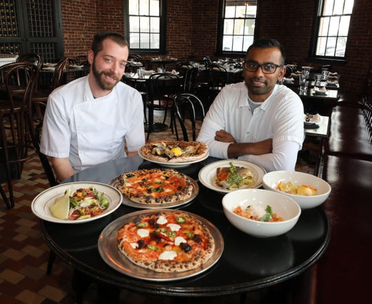Executive Chef William Eschner, left, with Village Social Restaurant Group Corporate Chef Mogan Anthony, right, with some of their food at Locali Pizza Bar and Kitchen in the Mount Kisco train station March 8, 2019.