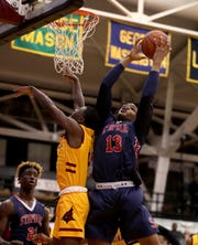 Malcolm Chimezie of Stepinac pulls down a rebound against Cardinal Hayes during a CHSAA semifinal basketball game at Fordham University March 7, 2019. Stepinac defeated Cardinal Hayes 77-65.