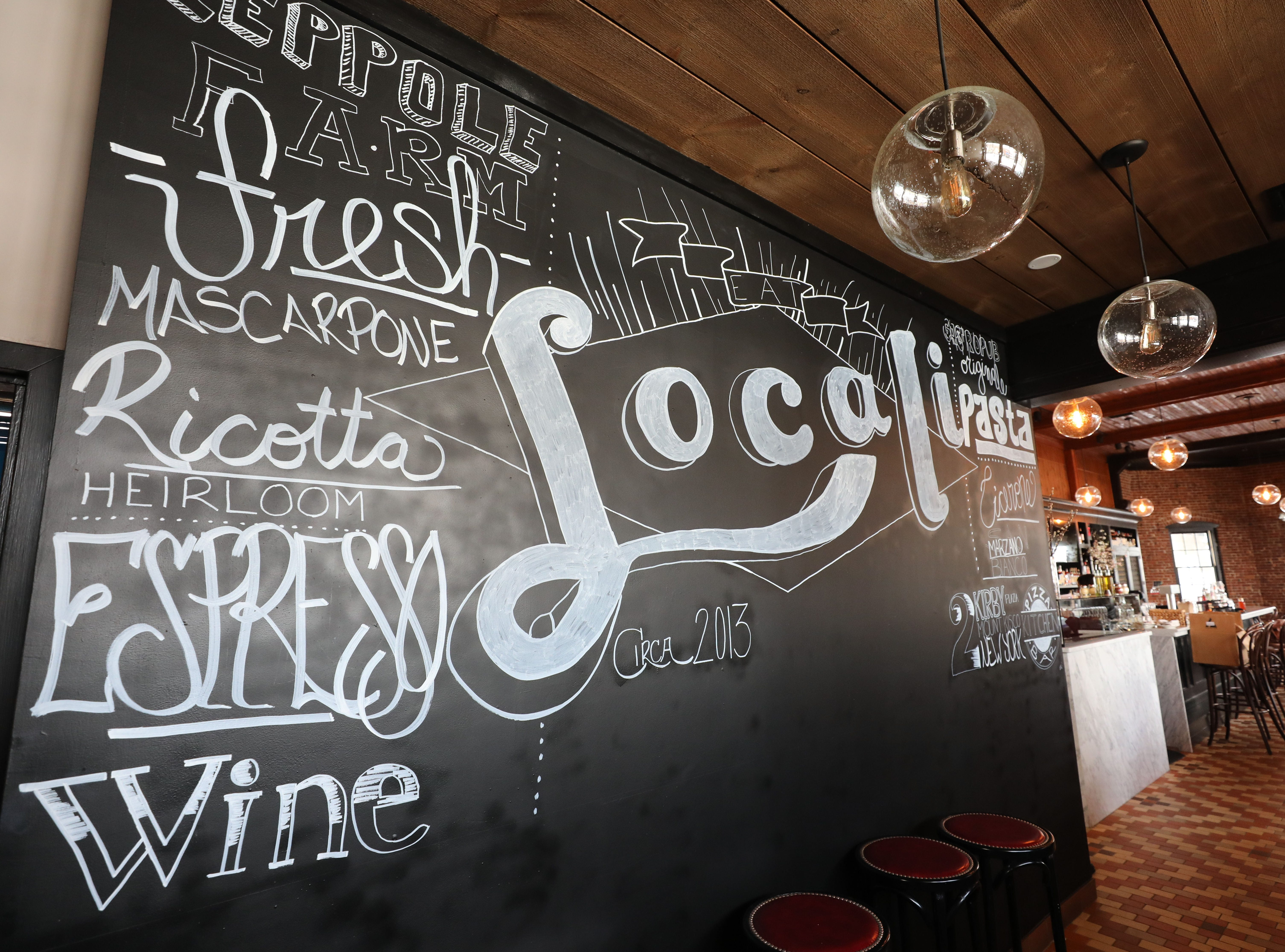 A large chalkboard at Locali Pizza Bar and Kitchen in the Mount Kisco railroad station, March 8, 2019.