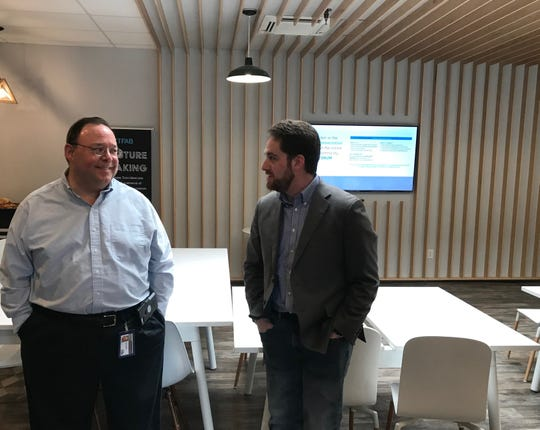 Adam Salamon, right, founder of Pression Inc., speaks at a co-working space in Wilmington, following a talk with Federal Communications Commission Chairman Ajit Pai.